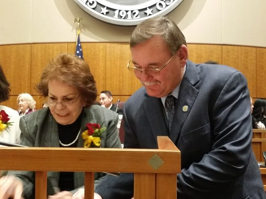 Sen.Fulfer signs official Senate roster presented by Chief Clerk Lenore Naranjo Jan. 15.