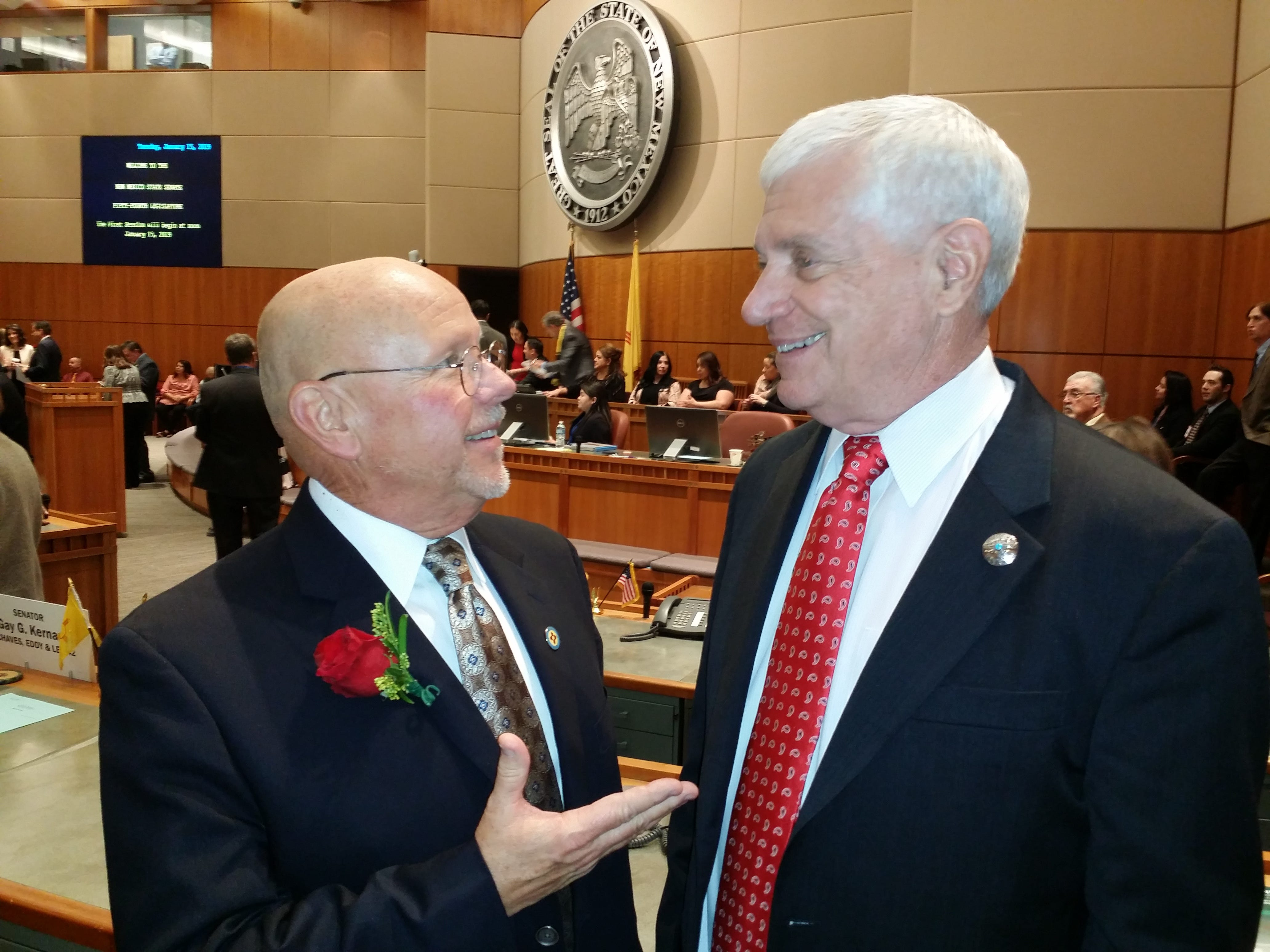 Senator Bill Burt, left, and Senator Ron Griggs, right,  visit prior to opening day ceremonies at the Roundhouse in Santa Fe Jan. 15.