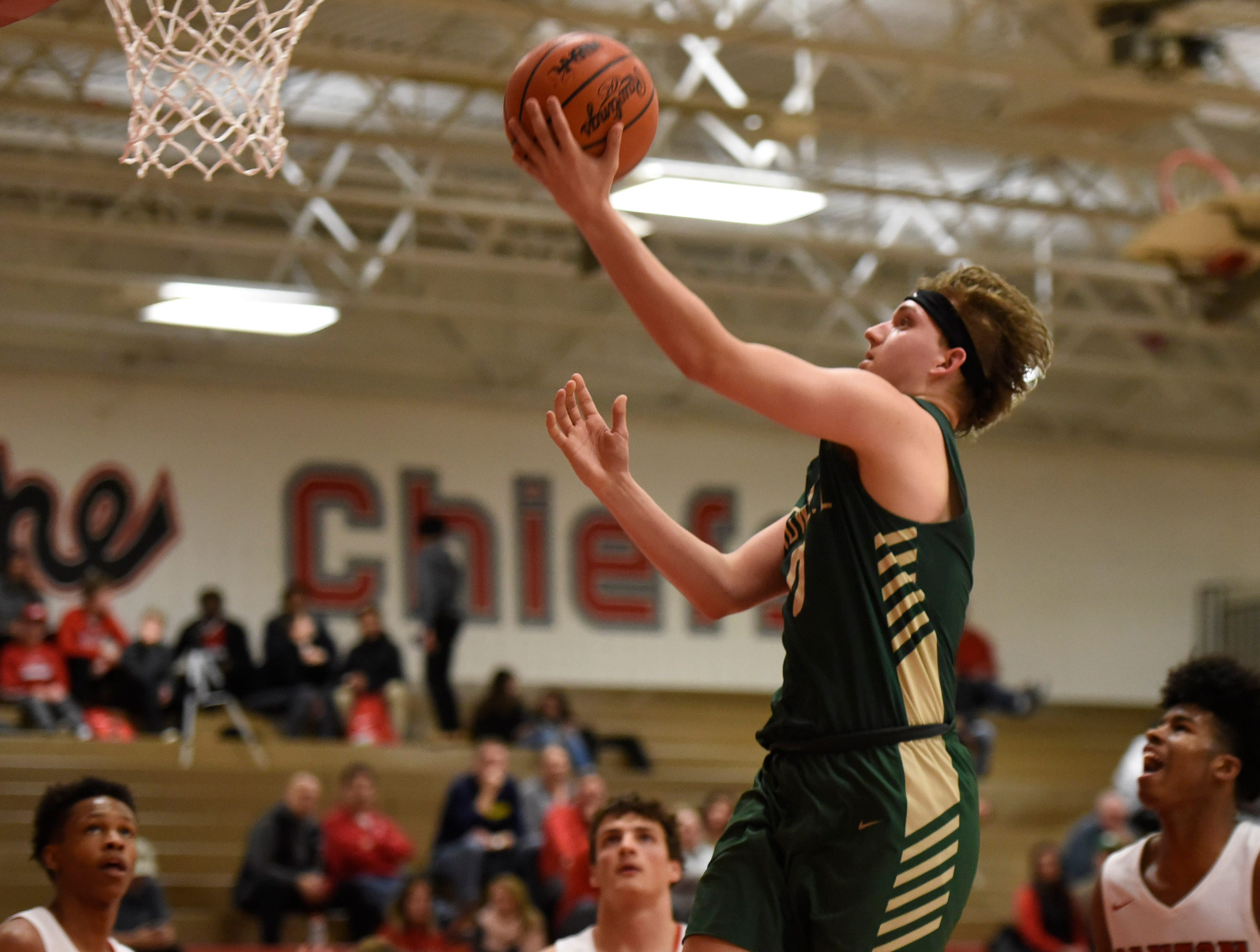 Howell Josh Palo (0) lays in a basket against Canton during a KLAA match up won by the Chiefs 74-62 played at Canton Jan. 15, 2019