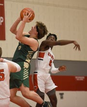 Howell's Josh Palo (0) and Canton's Vinson Sigmon (0) during a KLAA match up won by Canton 74-62 played at Canton Jan. 15, 2019