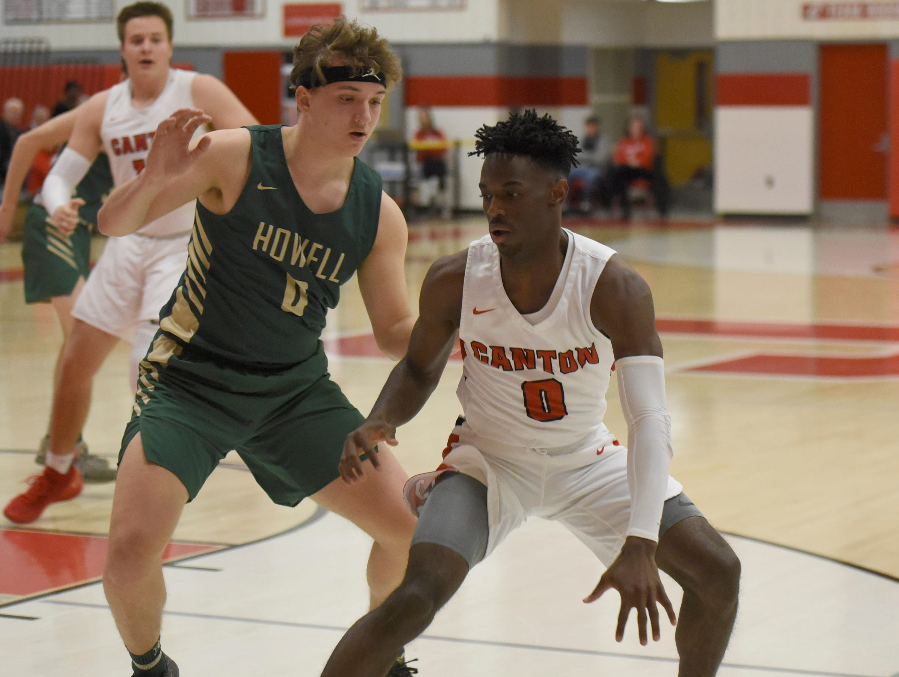 Howell's Josh Palo (0) and Canton's Vinson Sigmon (0) during a KLAA match up played at Canton Jan. 15, 2019