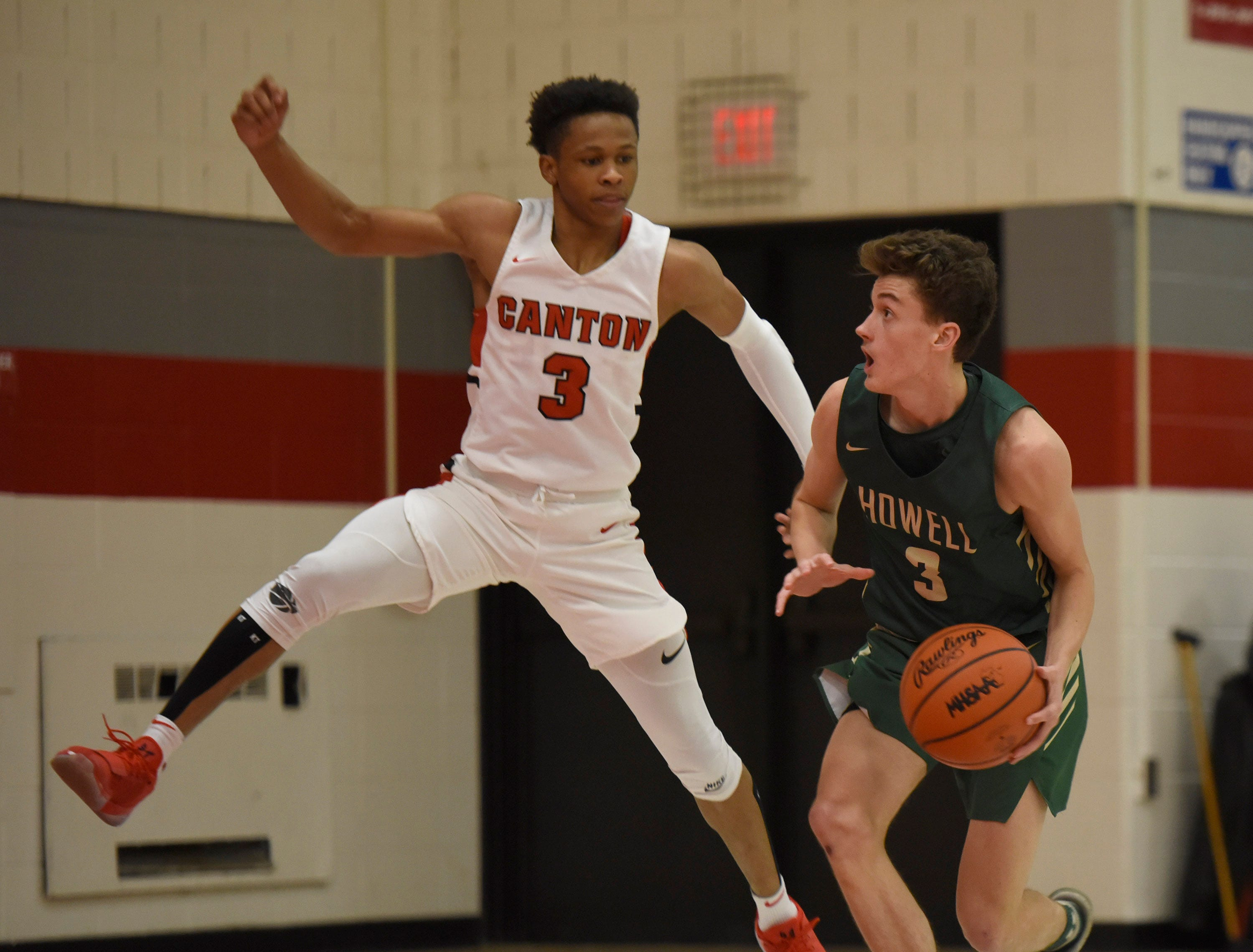 Howell's Kip French (3) and Canton's B. Artis White (3) during a KLAA match up won by Canton 74-62 played at Canton Jan. 15, 2019