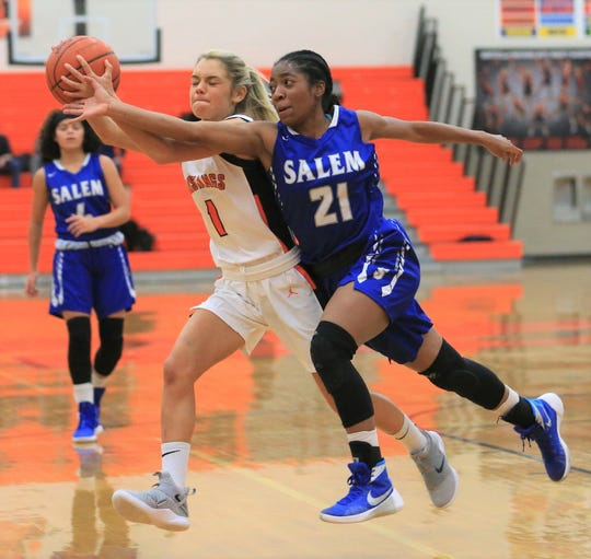 Salem's Mattison Joyner (21) and Northville's Jenna Lauderback contest for the loose ball in a KLAA West Division clash on Jan. 15.