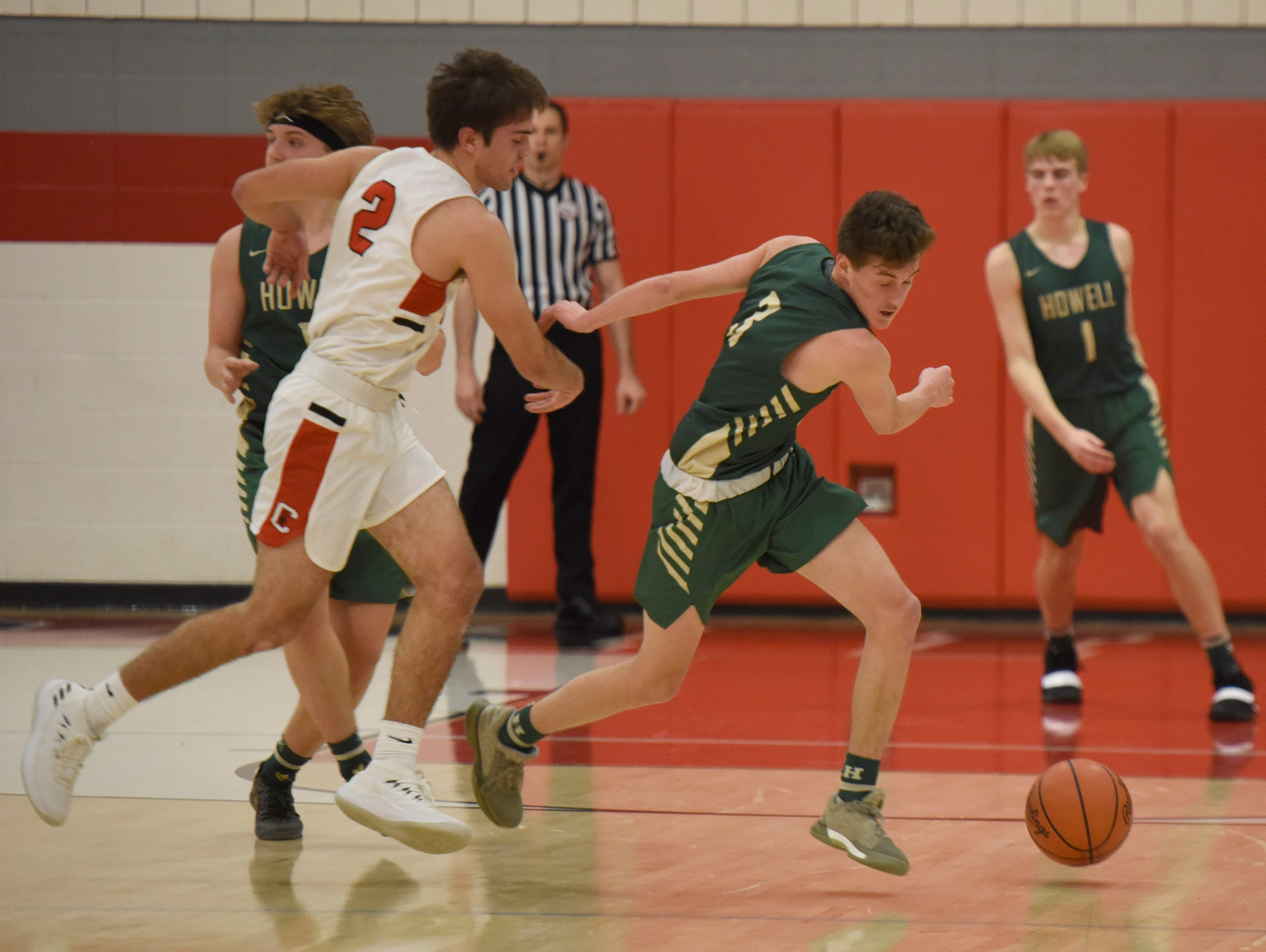 Canton's Liam Radomski (2) and Howell's Kip French (3) during a KLAA match up won by Canton 74-62 played at Canton Jan. 15, 2019