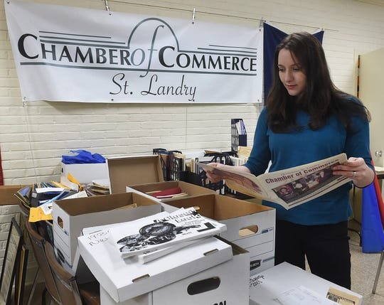 St. Landry Chamber of Commerce CEO Raquella Manuel searches through chamber archives preparing for the 100th anniversary of the chamber of commerce in Opelousas.