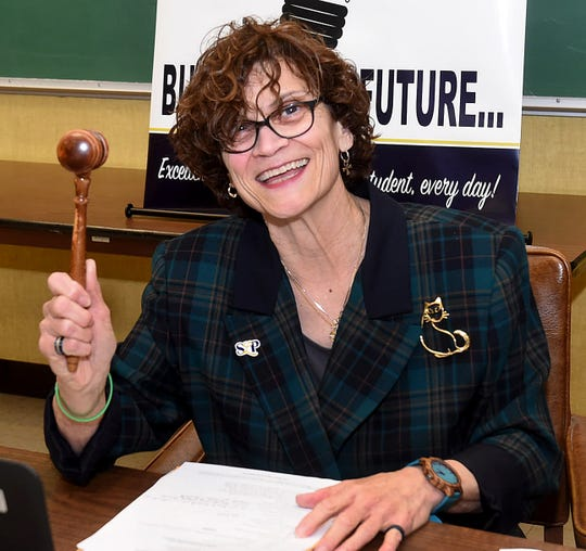 Mary Ellen Donatto holds up her gavel after she was selected to serve as St. Landry Parish School Board president.