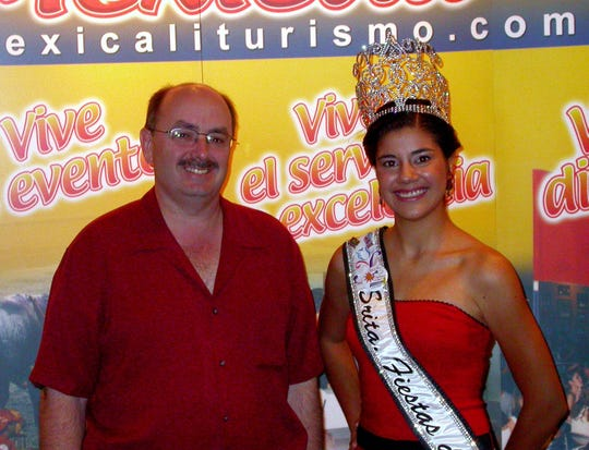 In this 2013 file photo,  Greg Pettis, mayor of Cathedral City and Susana Pelago, sunfestival queen to promote tourism in Mexicali.