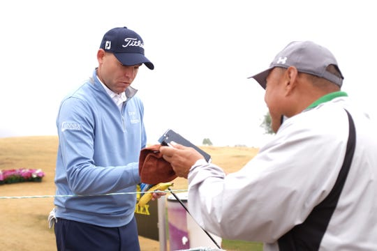 Bill Haas autographs Toronto, Canada, resident, Sam Xue's cap at the Desert Classic on Wednesday, January 16, 2019