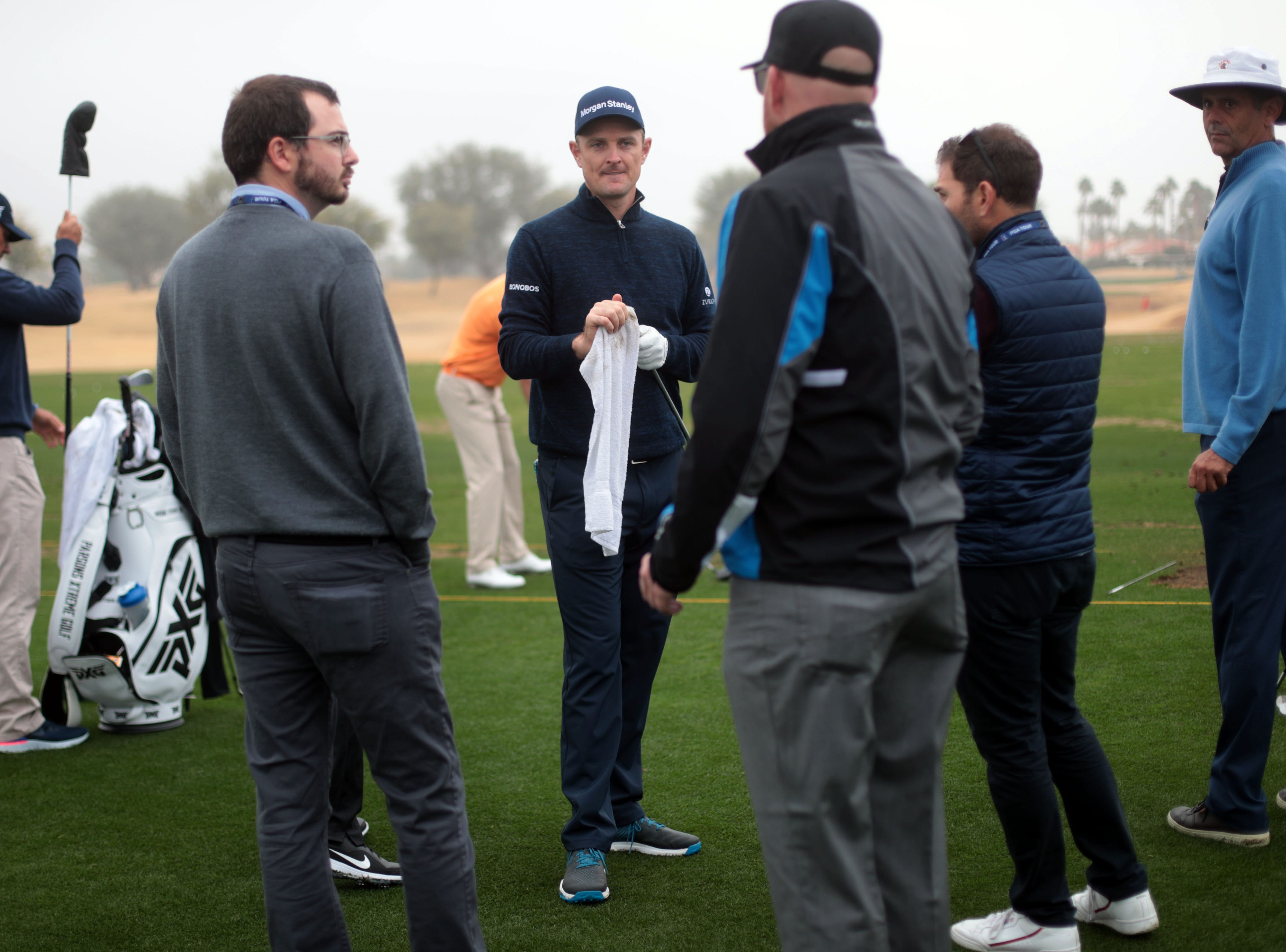 Justin Rose, center, on the driving range at the Desert Classic on Wednesday, January 16, 2019 in La Quinta.