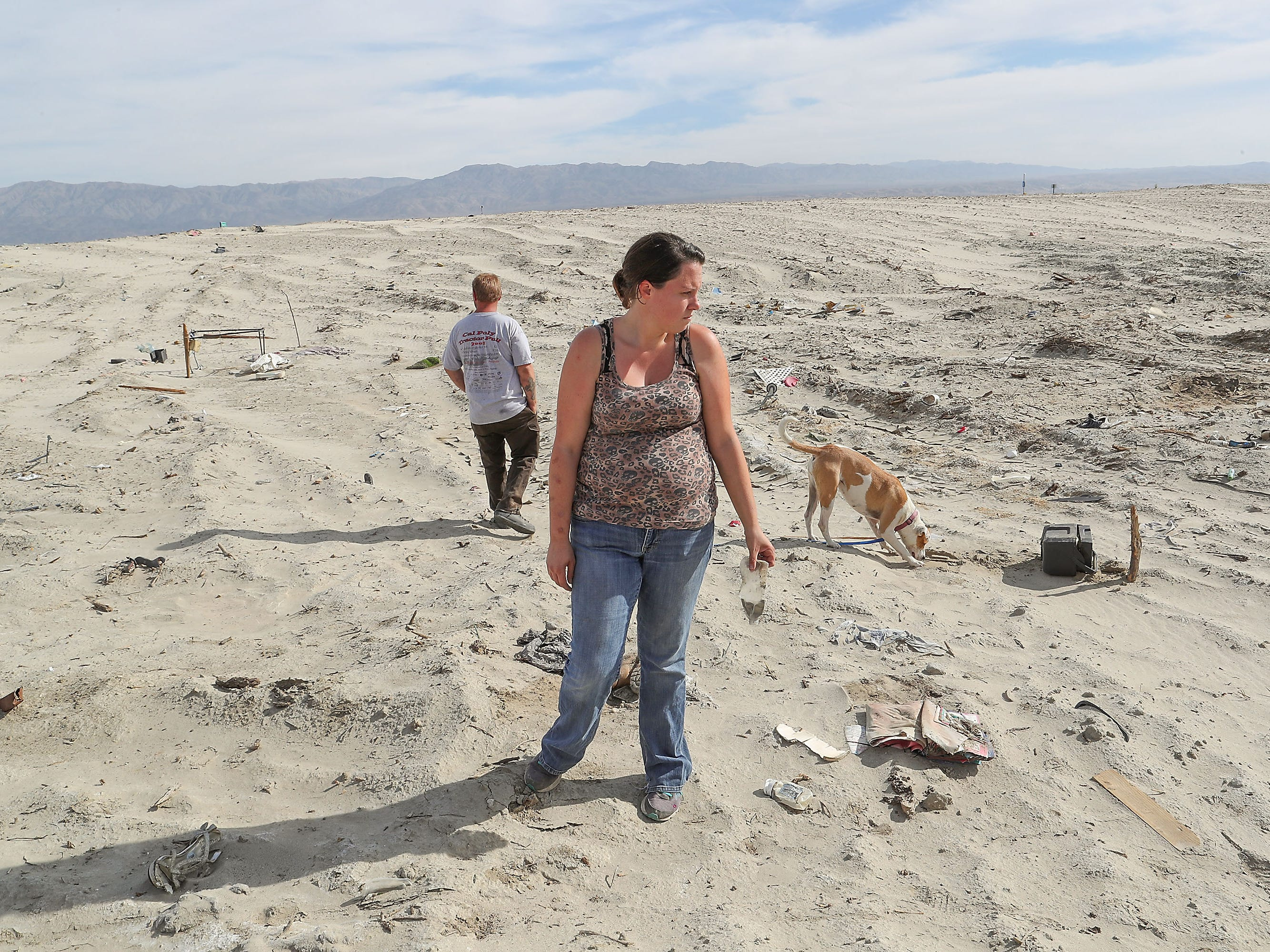 In October 2018, Bryan Hensley and Carene Riale return to the site where they previously lived in Coachella before Caltrans razed their community in May 2018. Broken pieces of wood and debris were buried under the sand.