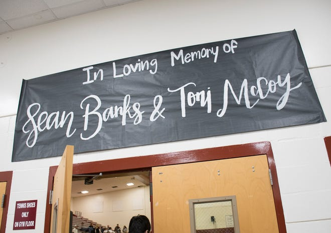 A sign above the gym door honors Sean Banks and Antoinette McCoy prior to the Gulf Breeze vs Tate boys basketball at Tate High School in Cantonment on Tuesday, January 15, 2019.  Sean Banks, 15, and sister Antoinette McCoy, 22, were both killed by an alleged drunk driver on Saturday.