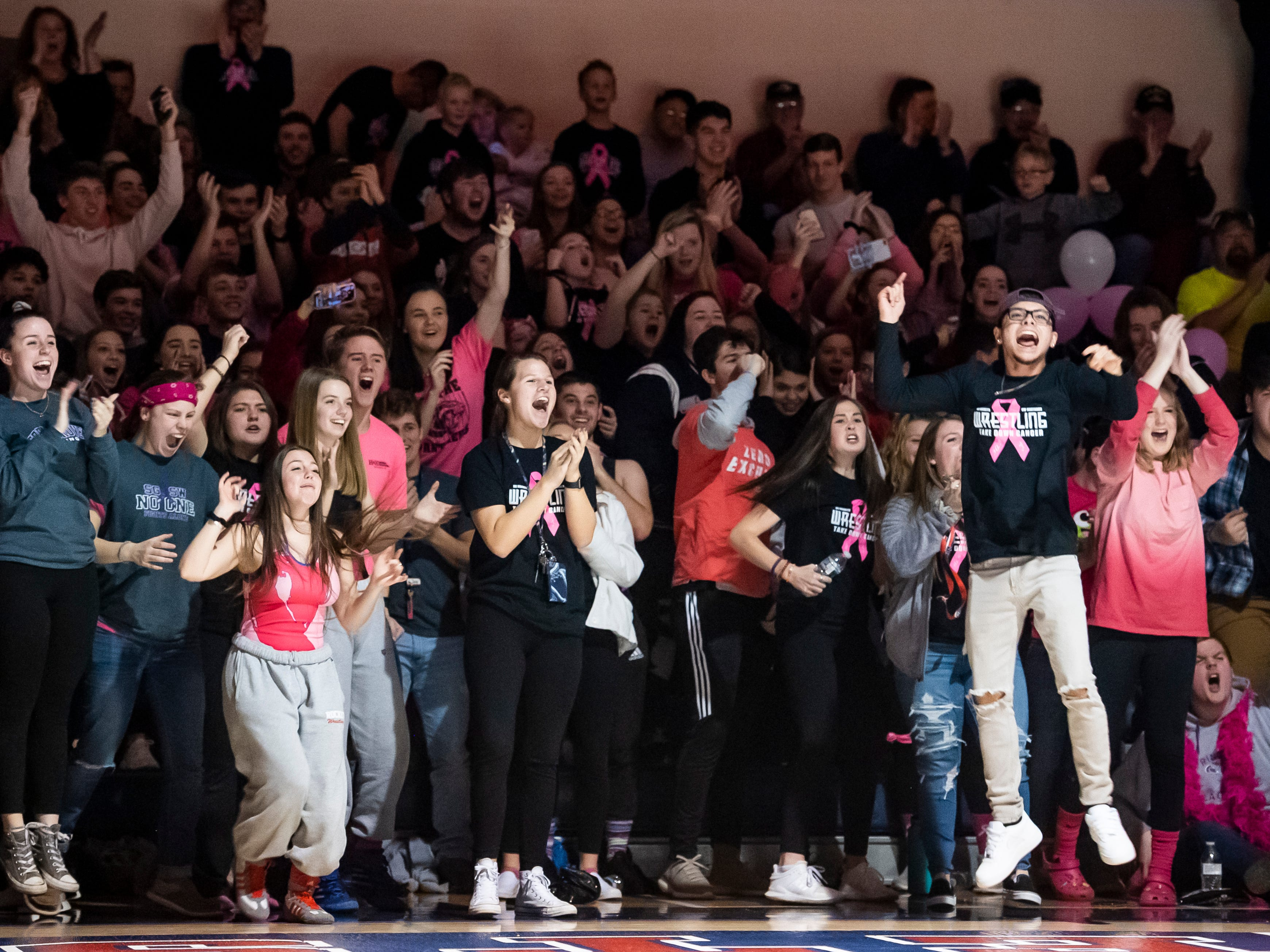 The Spring Grove student section erupts after Eric Glass pins South Western's Nathan Hawkins during the final bout (195 pounds) on Tuesday, Jan. 15, 2019. The pin gave Spring Grove the win 36-25 during the Rockets' annual 'Take Down Cancer' match, which raised $44,250 for the Heather L. Baker Foundation.