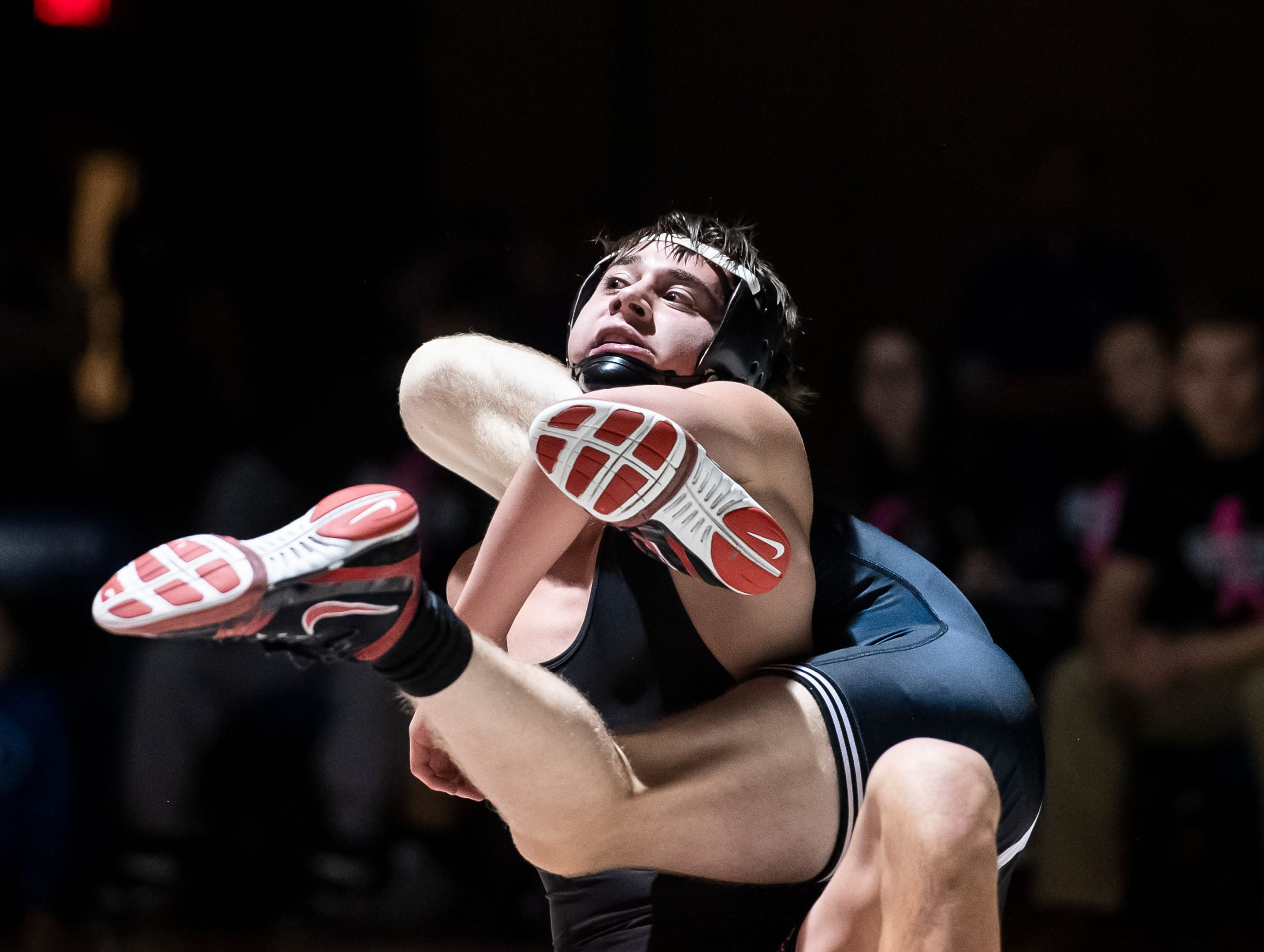 Spring Grove's Alec Villareal, top, wrestles South Western's Kasey Doll during the 126-pound bout. Doll won the match, 14-6, Tuesday, Jan. 15, 2019. Spring Grove beat the Mustangs 36-25 during the Rockets' annual 'Take Down Cancer' match, which raised $44,250 for the Heather L. Baker Foundation.
