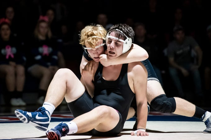 South Western's Ethan Dunnock, back, wrestles Spring Grove's Calvin Flemmens during the 220-pound bout. Dunnock won the match, 8-2, Tuesday, Jan. 15, 2019. Spring Grove beat the Mustangs 36-25 during the Rockets' annual 'Take Down Cancer' match, which raised $44,250 for the Heather L. Baker Foundation.