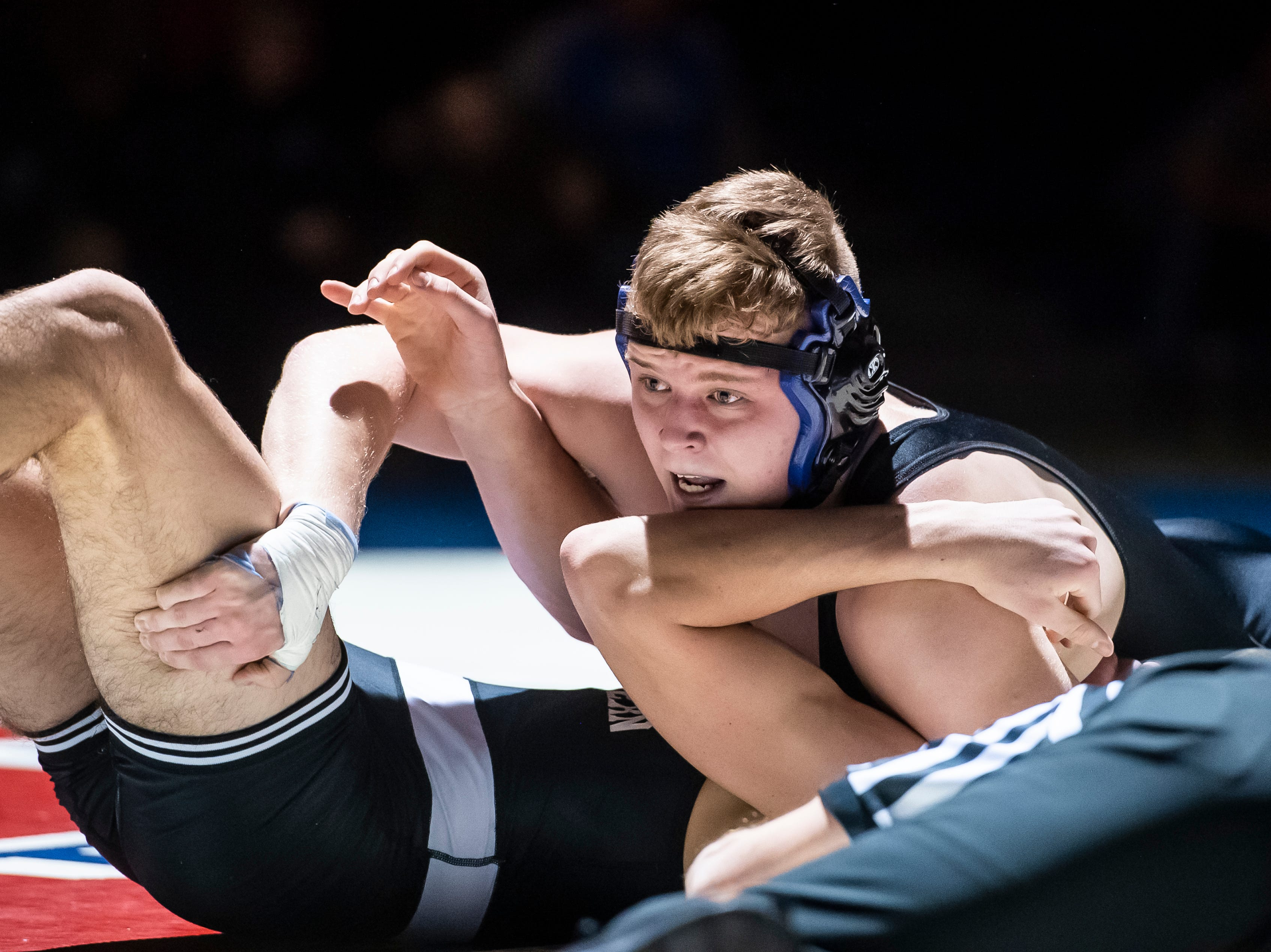 Spring Grove's Eric Glass, top, pins South Western's Nathan Hawkins during the 195-pound bout on Tuesday, Jan. 15, 2019. The pin gave Spring Grove the win 36-25 during the Rockets' annual 'Take Down Cancer' match, which raised $44,250 for the Heather L. Baker Foundation.