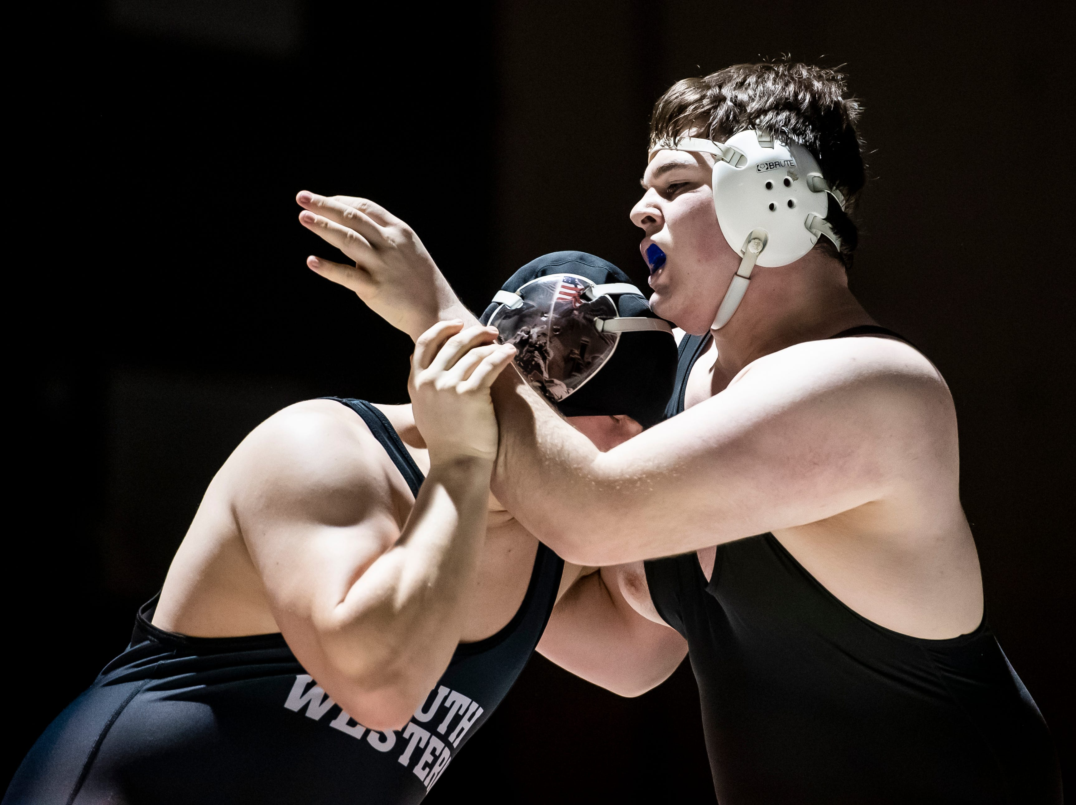 Spring Grove's Seth Worley, right, wrestles South Western's Tommy Morris during the 285-pound bout. Worley won the match, 3-1, Tuesday, Jan. 15, 2019. Spring Grove beat the Mustangs 36-25 during the Rockets' annual 'Take Down Cancer' match, which raised $44,250 for the Heather L. Baker Foundation.