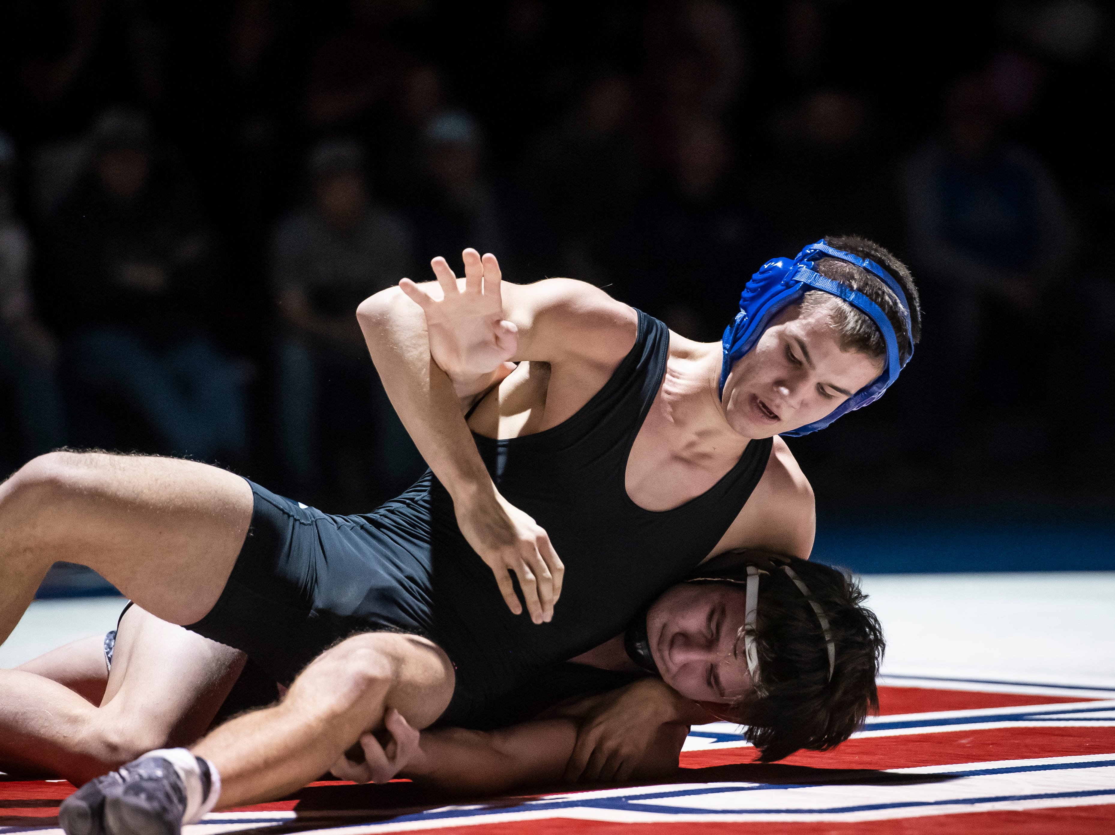 Spring Grove's Brady Pitzer, bottoms, wrestles South Western's Cameron Stevens during the 145-pound bout. Stevens won the match, 9-4, Tuesday, Jan. 15, 2019. Spring Grove beat the Mustangs 36-25 during the Rockets' annual 'Take Down Cancer' match, which raised $44,250 for the Heather L. Baker Foundation.