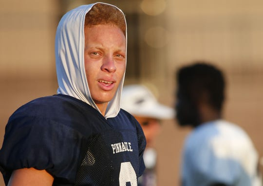 Spencer Rattler, Pinnacle High's quarterback, takes a break during practice at Pinnacle High in Phoenix on August 22, 2018.