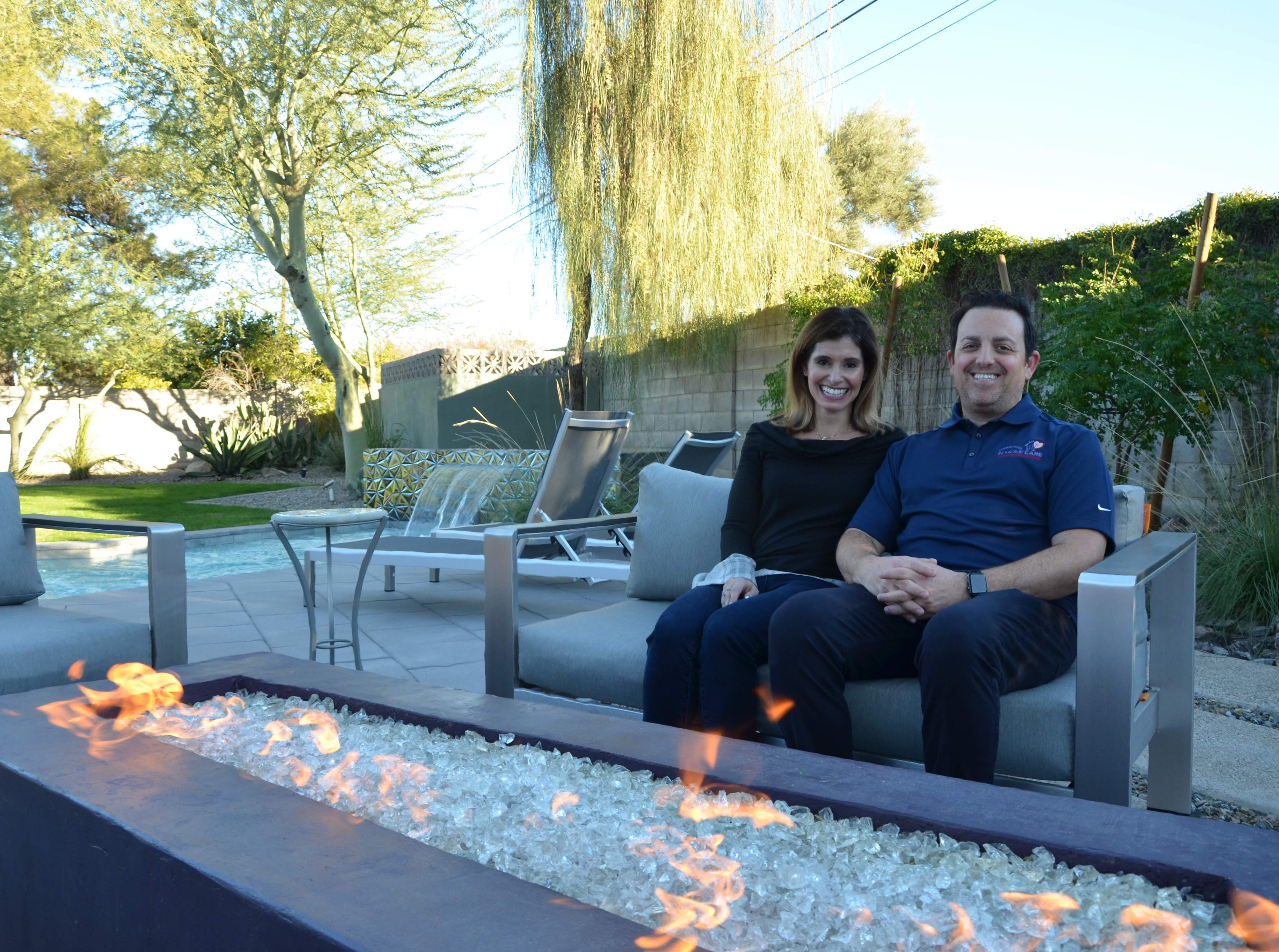 Denise and Eric Kaye love their resort-like backyard, which includes a pair of gas fire pits.