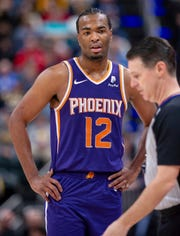 Phoenix Suns forward T.J. Warren (12) reacts after being called for a technical foul during the first half of the team's NBA basketball game against the Indiana Pacers on Tuesday, Jan. 15, 2019, in Indianapolis.