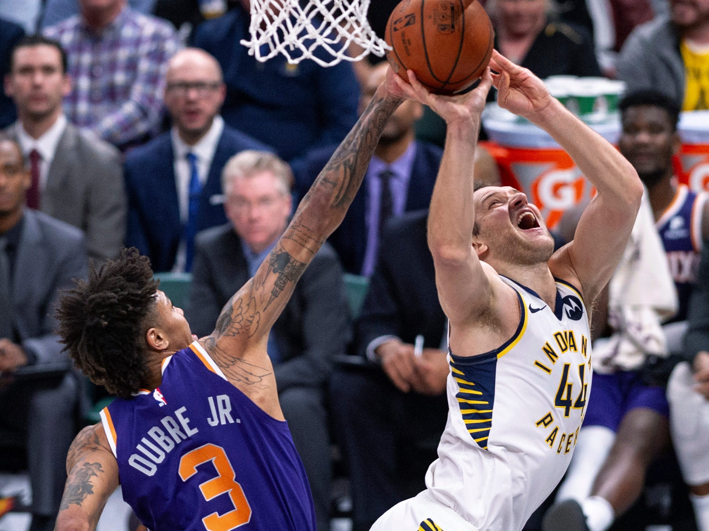 Indiana Pacers forward Bojan Bogdanovic (44) hits the backboard with his shot as he's defended by Phoenix Suns forward Kelly Oubre Jr. (3) during the second half of an NBA basketball game Tuesday, Jan. 15, 2019, in Indianapolis. The Pacers won 131-97. (AP Photo/Doug McSchooler)