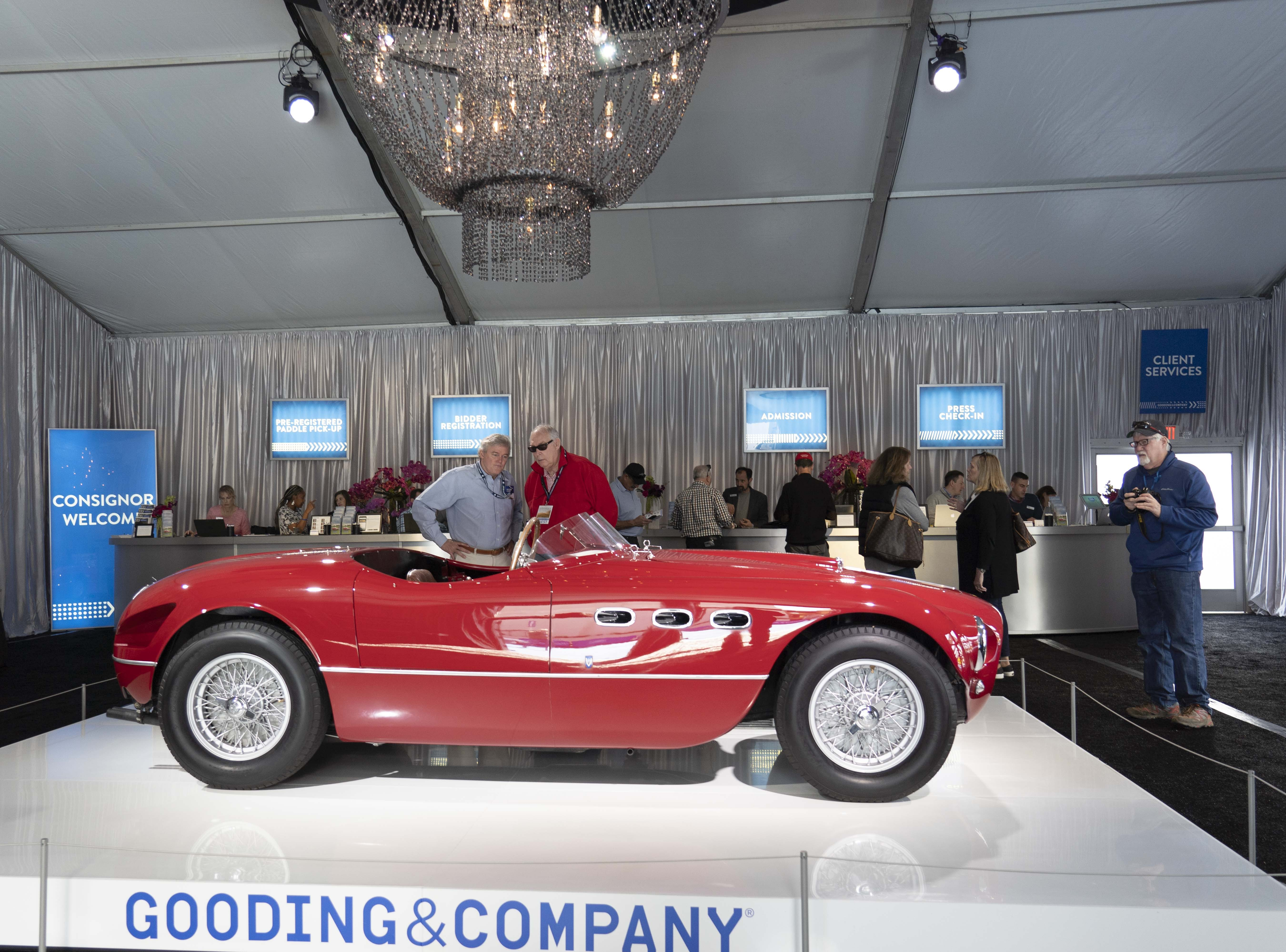 Car fans look at the 1953 Ferrari 250 MM Spider Series II for auction at Gooding & Co.'s preview day in Scottsdale.
