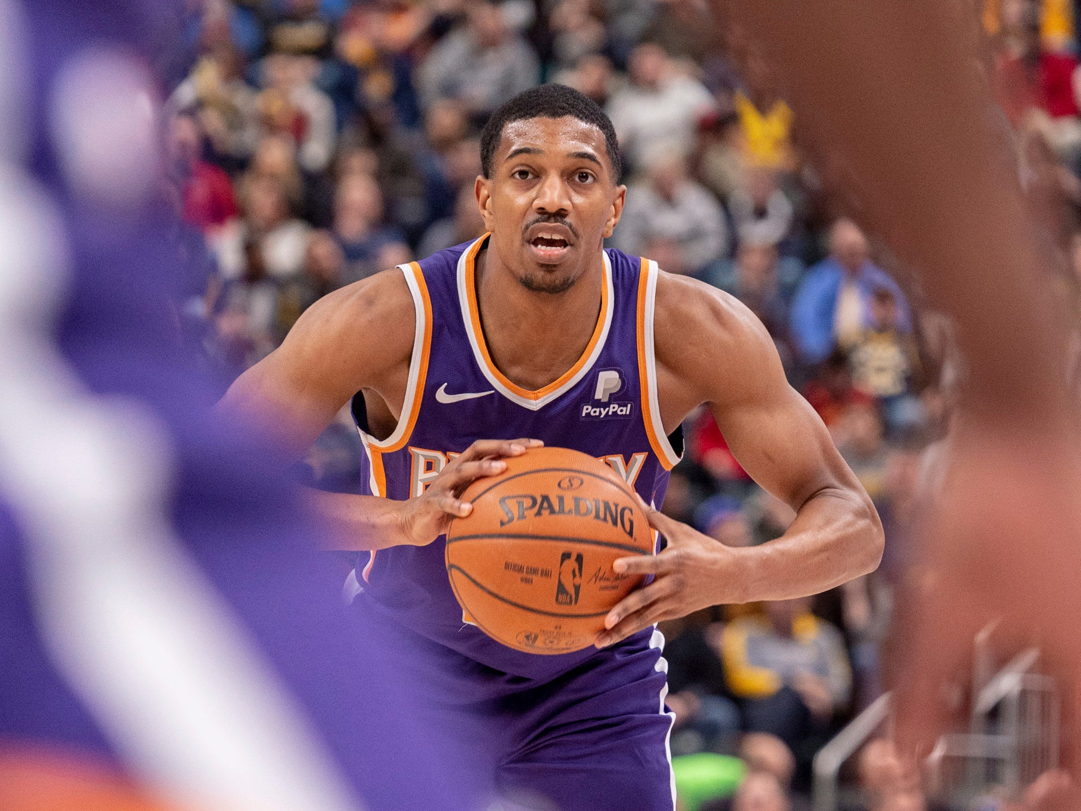 Phoenix Suns guard De'Anthony Melton (14) looks to pass the ball to a teammate during the first half of the team's NBA basketball game against the Indiana Pacers on Tuesday, Jan. 15, 2019, in Indianapolis.