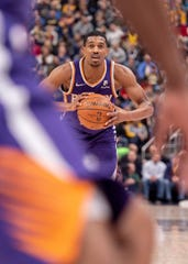 Suns rookie point guard De'Anthony Melton looks to pass the ball during a game against the Pacers.