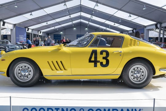 Car fans look at 1964 Ferrari 275 GTB Prototype for auction at Gooding & Co.'s preview day in Scottsdale.