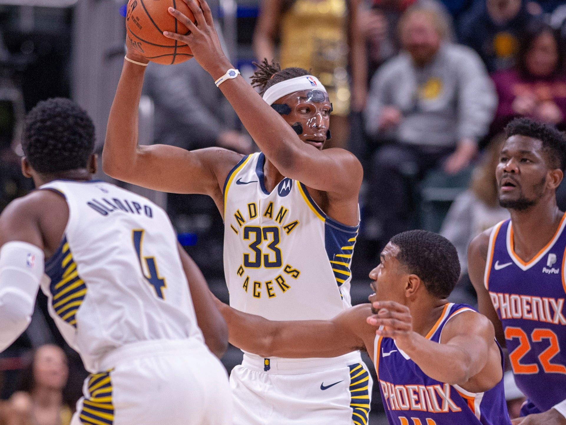Indiana Pacers center Myles Turner (33) keeps the ball from Phoenix Suns' De'Anthony Melton (14) during the first half of an NBA basketball game Tuesday, Jan. 15, 2019, in Indianapolis.