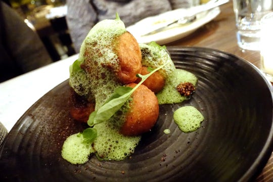 Vegetable beignets with black garlic mustard, vegetable ash and green goddess at The Larder + The Delta in Phoenix.