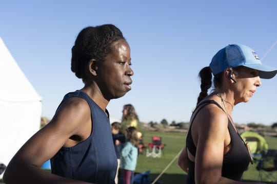 Runner Melinda Yelverton (left) participates in Across the Years, a 6-day endurance race at Camelback Ranch in Glendale, AZ.