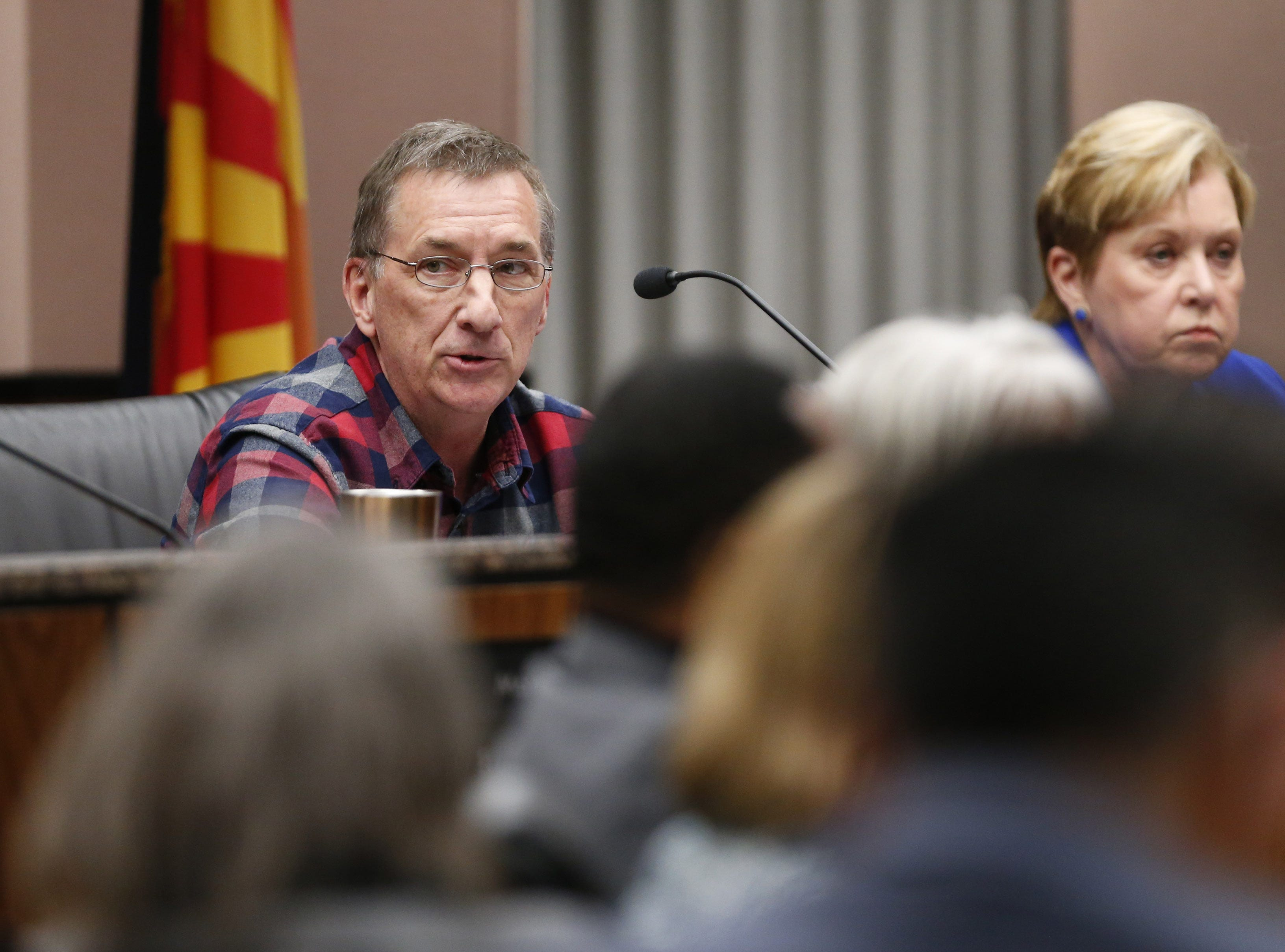 President Laurin Hendrix speaks after resigning during a special meeting of the Maricopa County Community College District Governing Board in Tempe January 15, 2019. His successor, Linda Thor, is seated next to him.