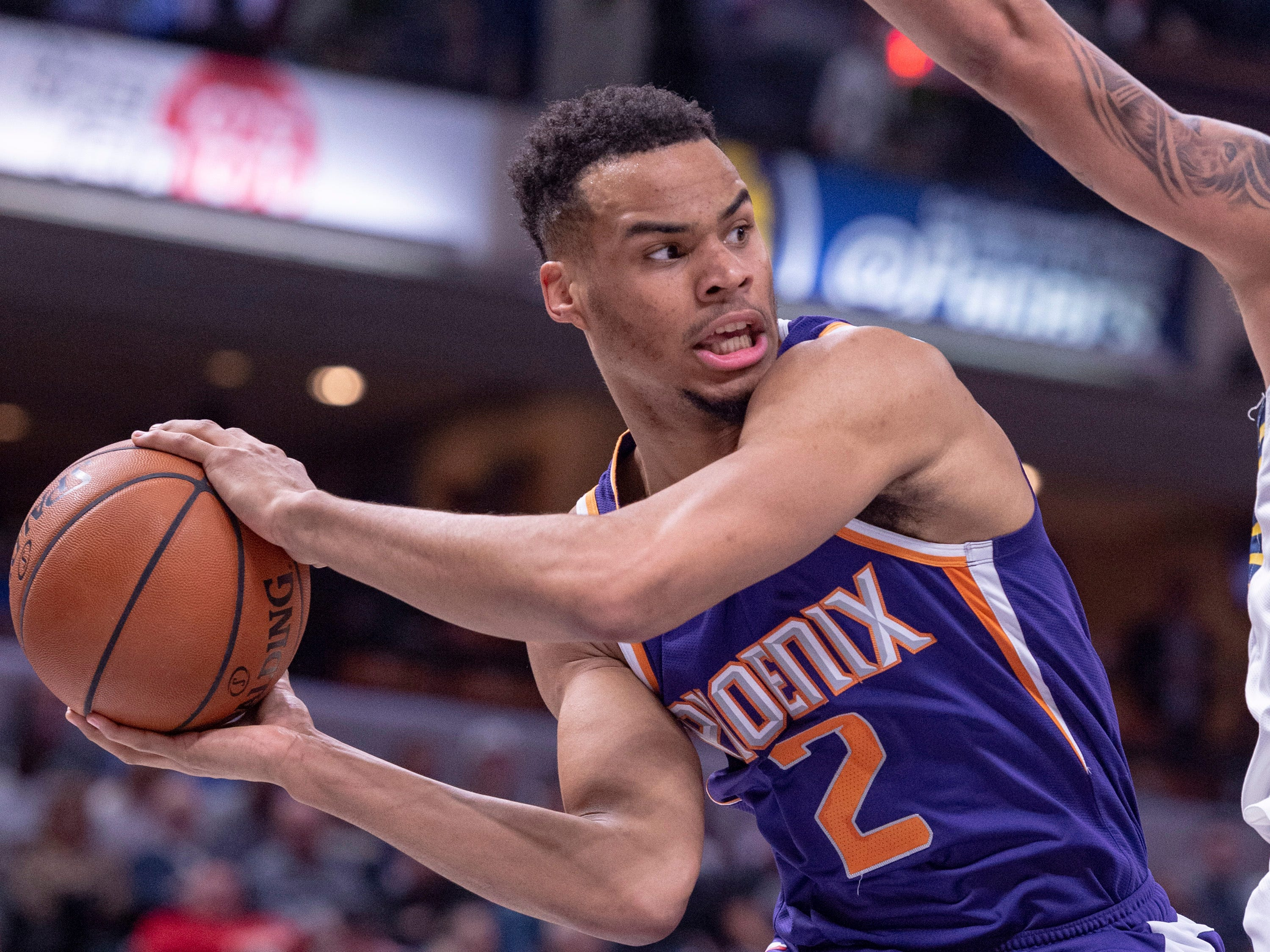 Phoenix Suns guard Elie Okobo (2) prepares to pass the ball to a teammate from the baseline during the first half of the Suns' NBA basketball game against the Indiana Pacers on Tuesday, Jan. 15, 2019, in Indianapolis.