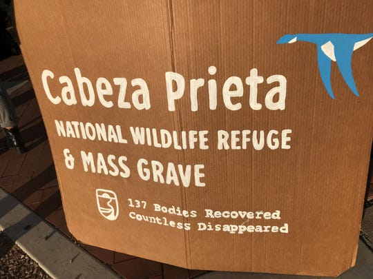 Supports of four humanitarian aid volunteers facing criminal charges for dropping off water at the Cabeza Prieta National Wildlife Refuge display this sign, showing the number of recovered human remains found in the remote desert wilderness.