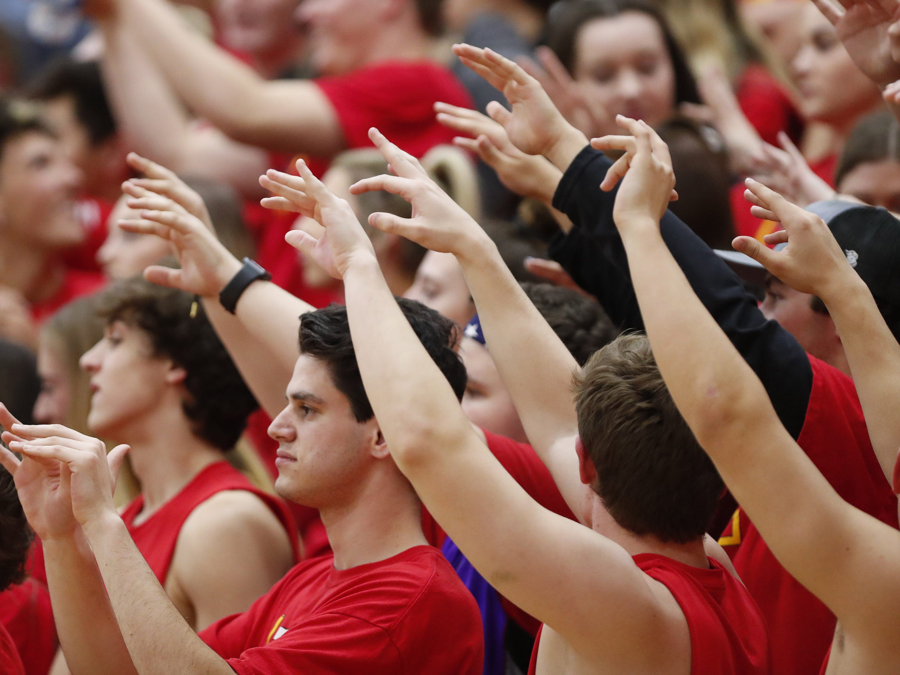 Chaparral students hold their hands up during a free throw against Pinnacle in Scottsdale January 15, 2019.