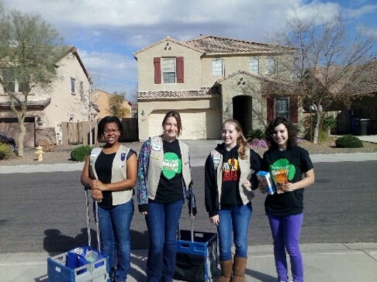 This year, the Girl Scouts' Walkabout campaign encourages them to walk their neighborhoods and sell door-to-door.