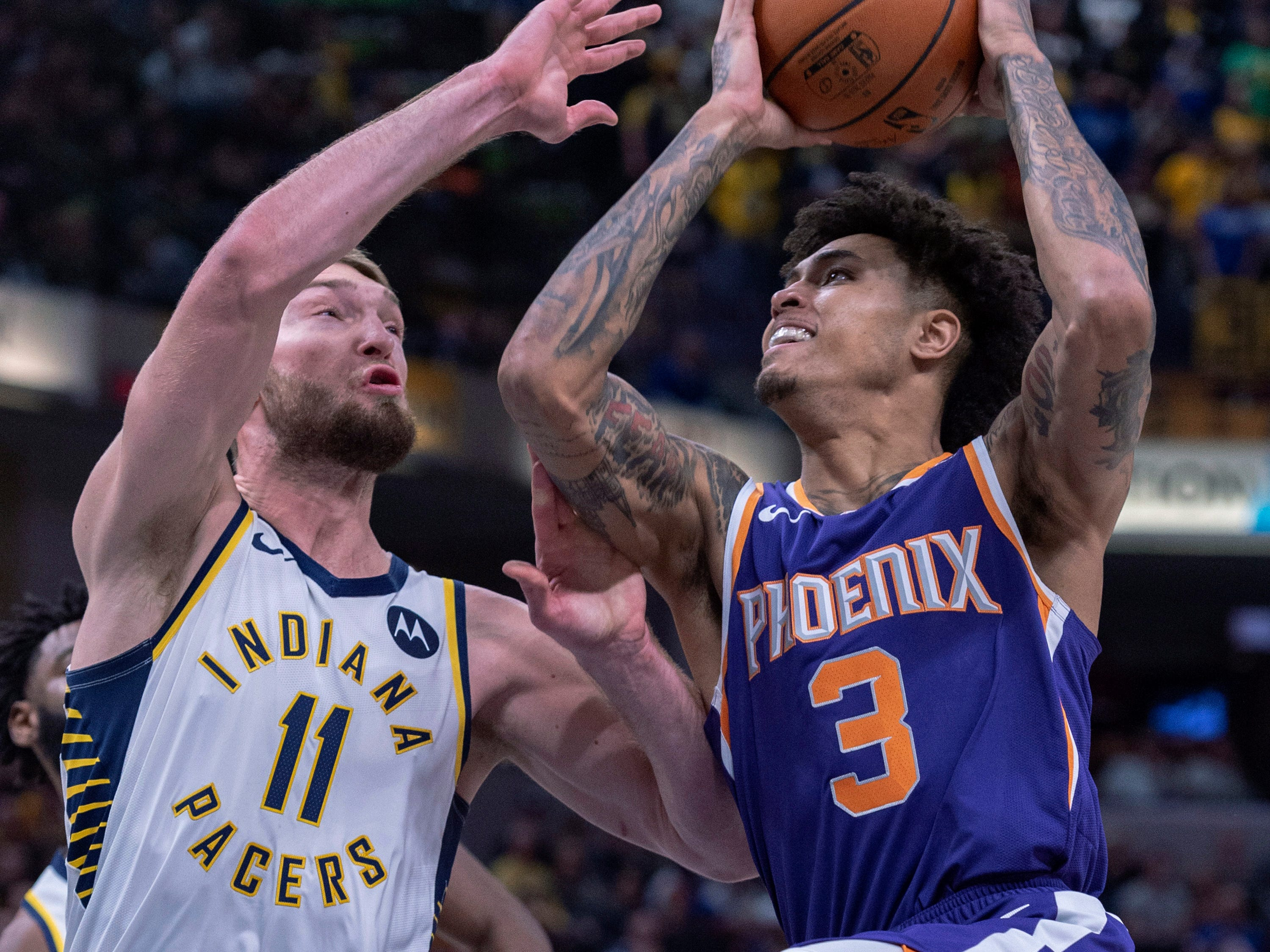 Phoenix Suns forward Kelly Oubre Jr. (3) is defended by Indiana Pacers forward Domantas Sabonis (11) during the first half of an NBA basketball game Tuesday, Jan. 15, 2019, in Indianapolis.