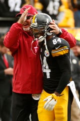 Pittsburgh Steelers wide receiver Antonio Brown (84) and Arizona Cardinals head coach Bruce Arians greet each other before an NFL football game, Sunday, Oct. 18, 2015 in Pittsburgh. It seems so long ago now.