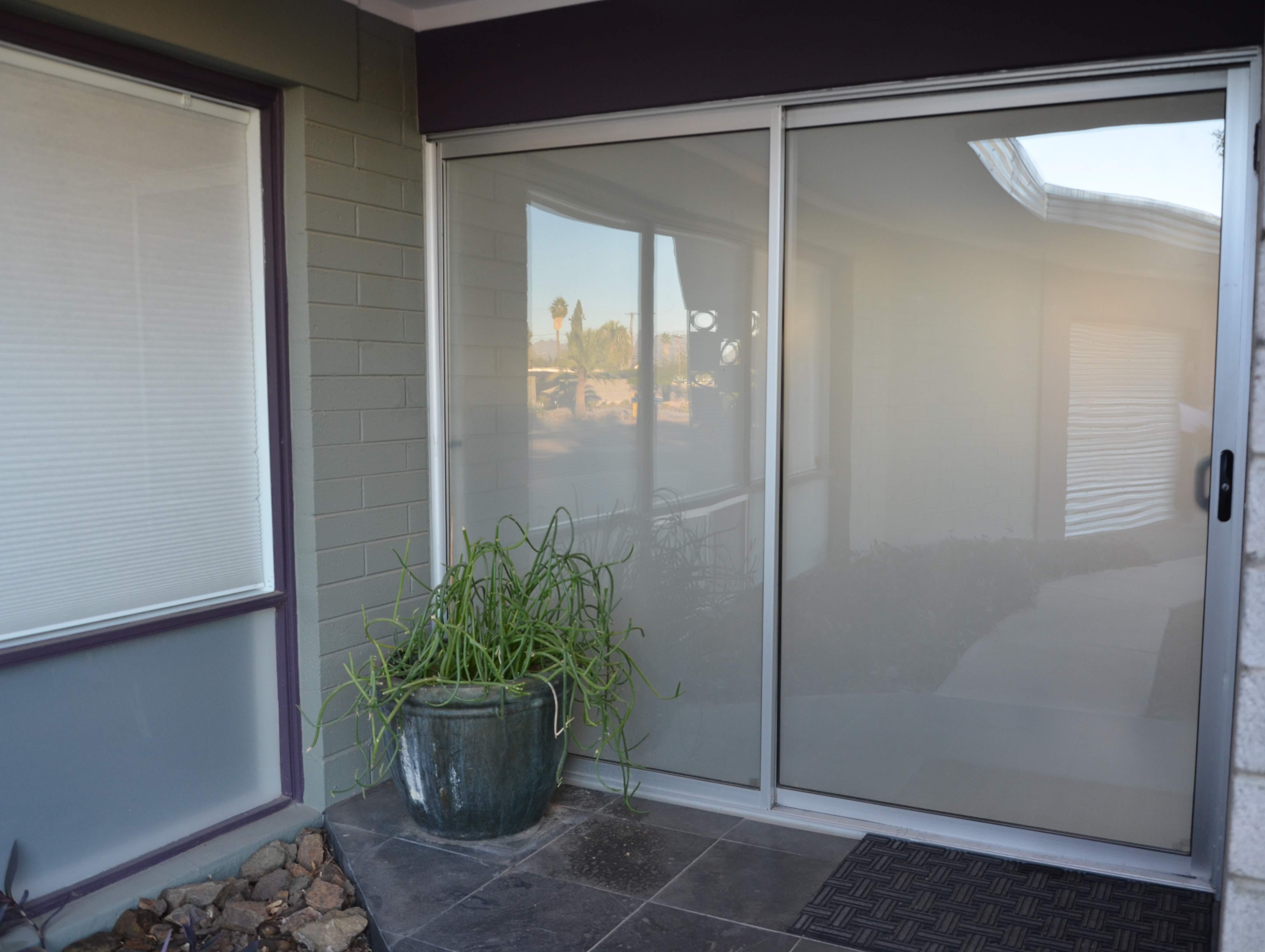 Visitors to the Kaye home enter through a frosted sliding glass door, which throws some visitors off.