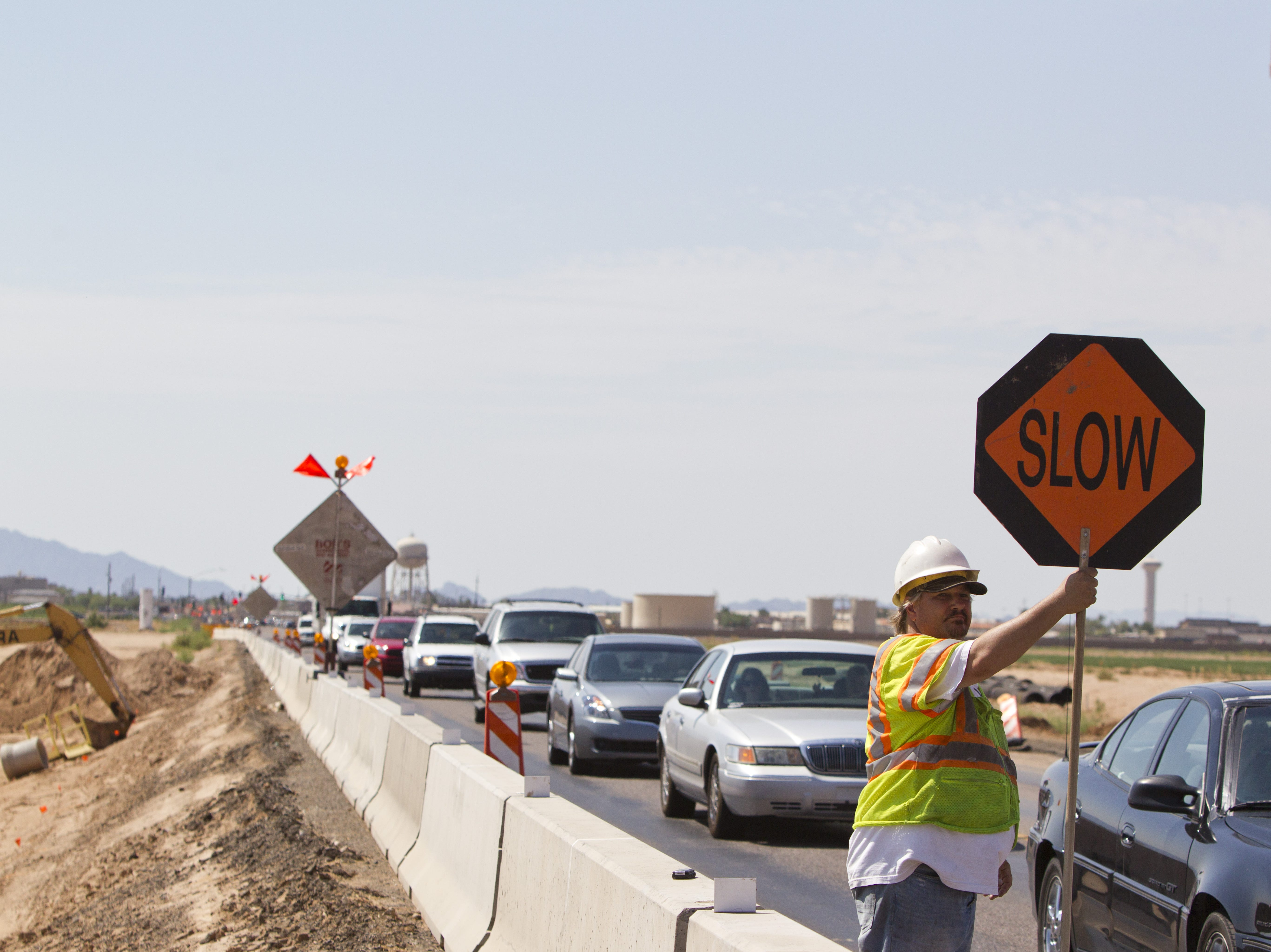 Chris Marko works on the  Northern Parkway, a major regional roadway project, near El Mirage in August 2012. Officials hope the Northern Parkway, which is resuming construction after a yearslong stall, will ease growing traffic congestion by providing an east-west corridor through El Mirage, Glendale and Peoria from Loop 303 to Grand Avenue.
