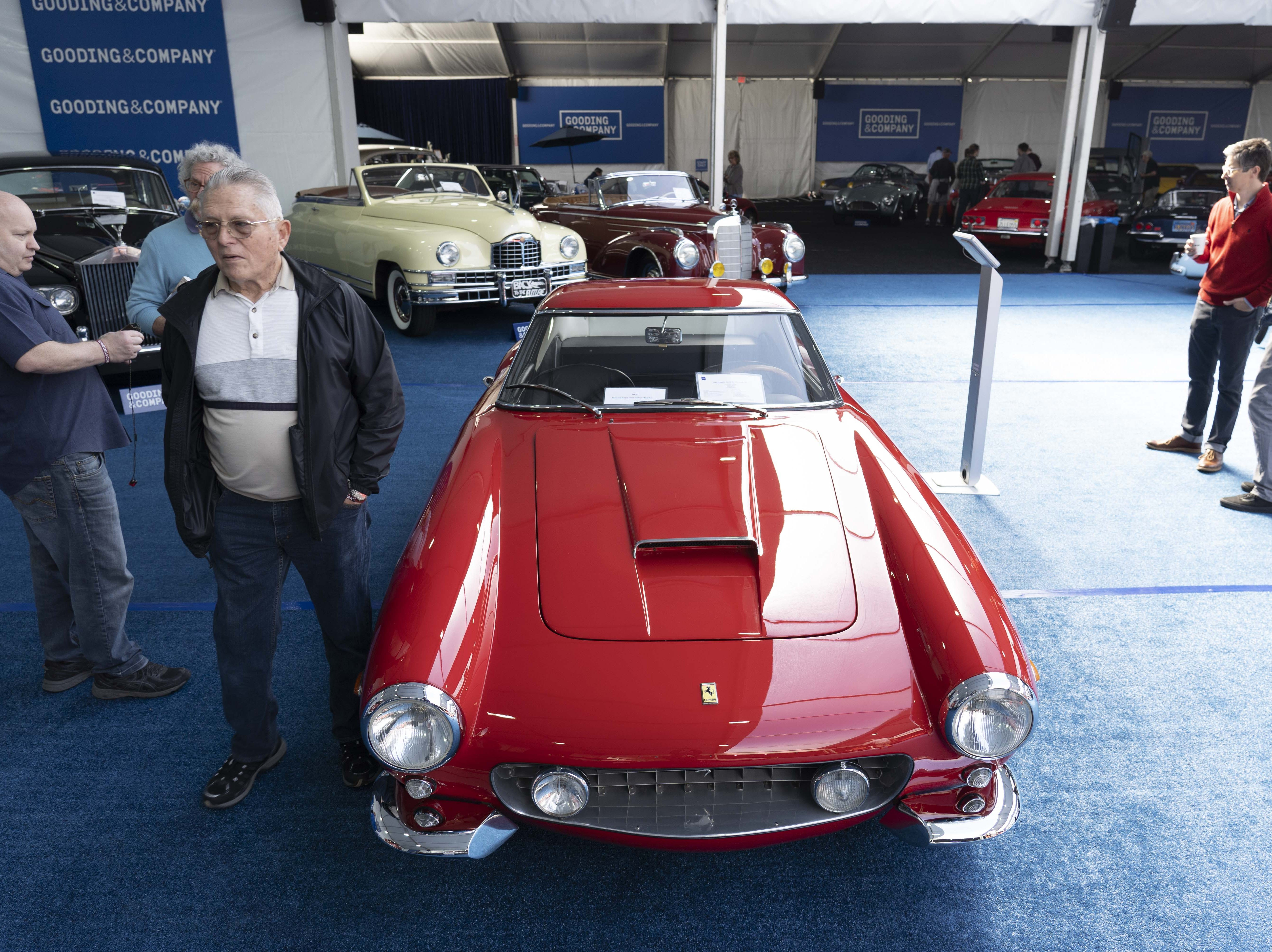 Car fans look at the 1963 Ferrari 250 GT SWB Berlinetta for auction at Gooding & Co.'s preview day in Scottsdale.