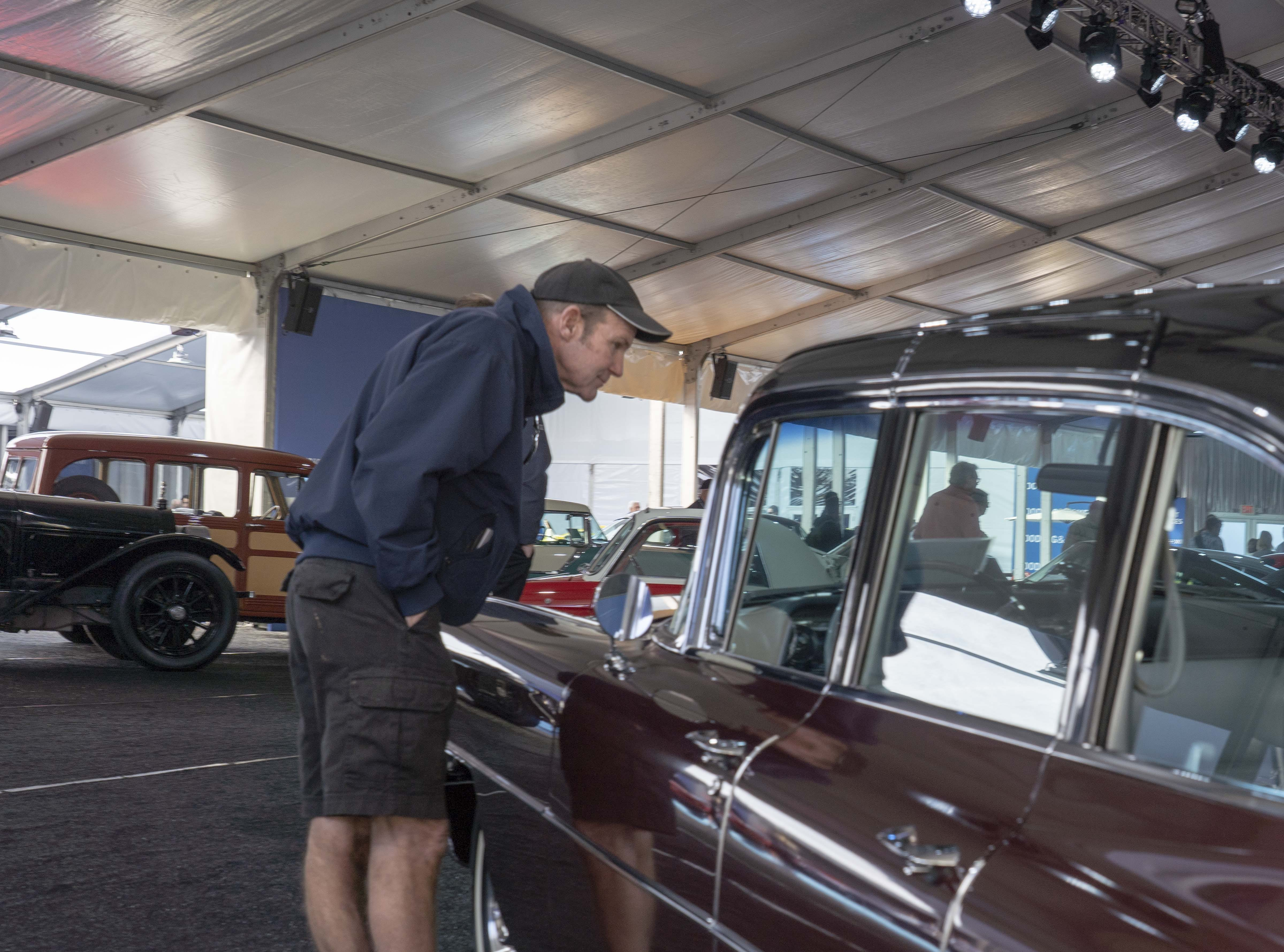 Tim McDonald look at different cars for auction at Gooding & Co.'s preview day in Scottsdale.