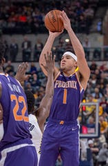Phoenix Suns guard Devin Booker (1) shoots during the first half of an NBA basketball game against the Indiana Pacers Tuesday, Jan. 15, 2019, in Indianapolis. (AP Photo/Doug McSchooler)