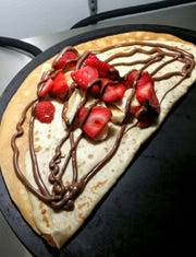 The strawberry & banana sweet crepe at Curbside Crepes is made with fresh strawberries, bananas and chocolate drizzle.