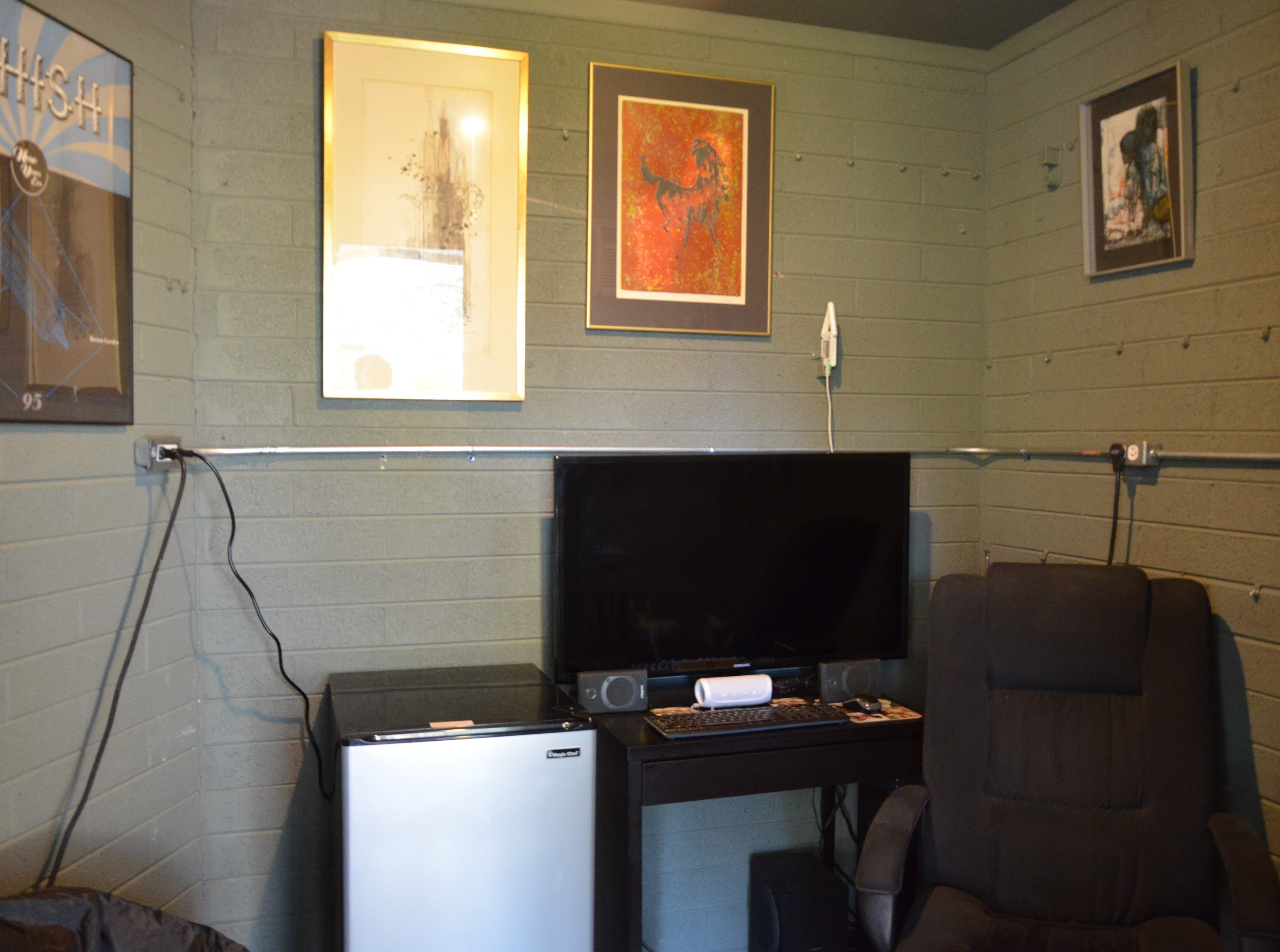 Eric transformed an unused storage space into a small home office. It doubles as a music room for him, and includes heat and air conditioning.