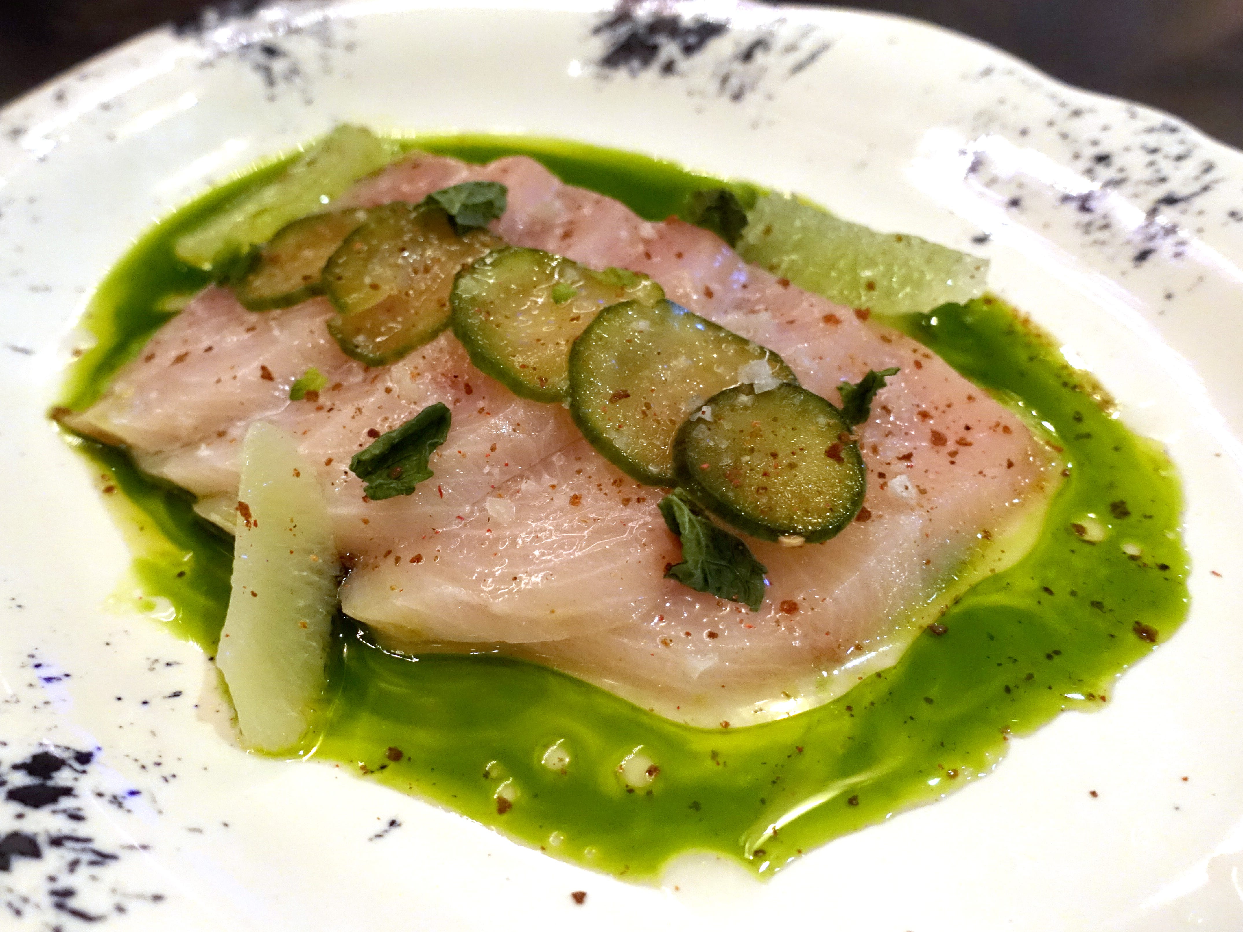 Hamachi with mint, lime, ginger marinated cucumber, pink peppercorns and herb oil at The Larder + The Delta in Phoenix.