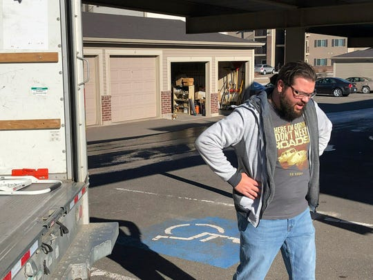 George Jankowski, a furloughed U.S. Department of Agriculture worker, helps a friend move out of an apartment in Cheyenne, Wyoming, on  Jan. 14, 2019. Jankowski was paid $30 for his help.