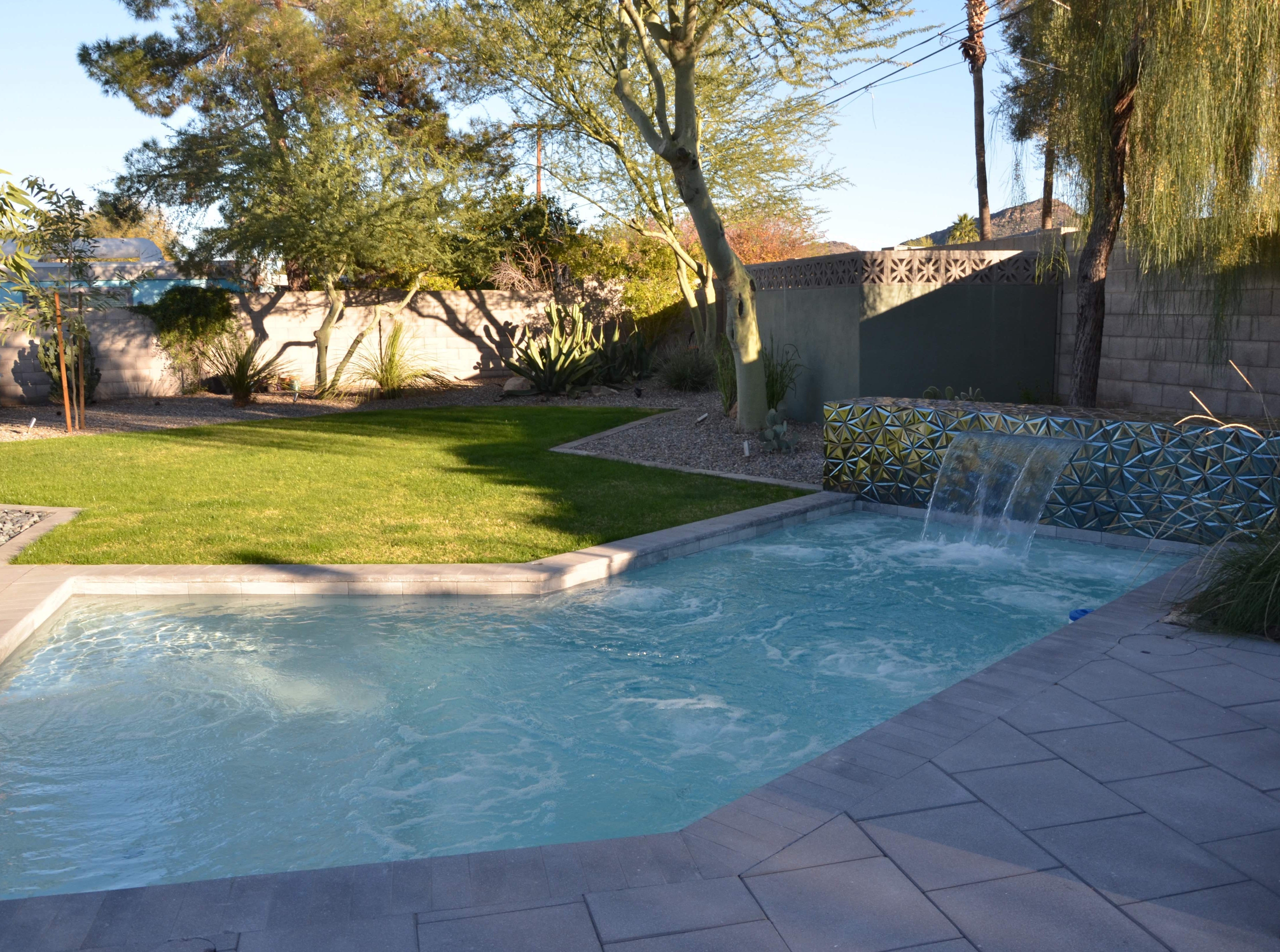 "The biggest part of the backyard renovation was a custom ""spool,"" which can be heated like a spa in the winter and cooled like a pool for the summer."