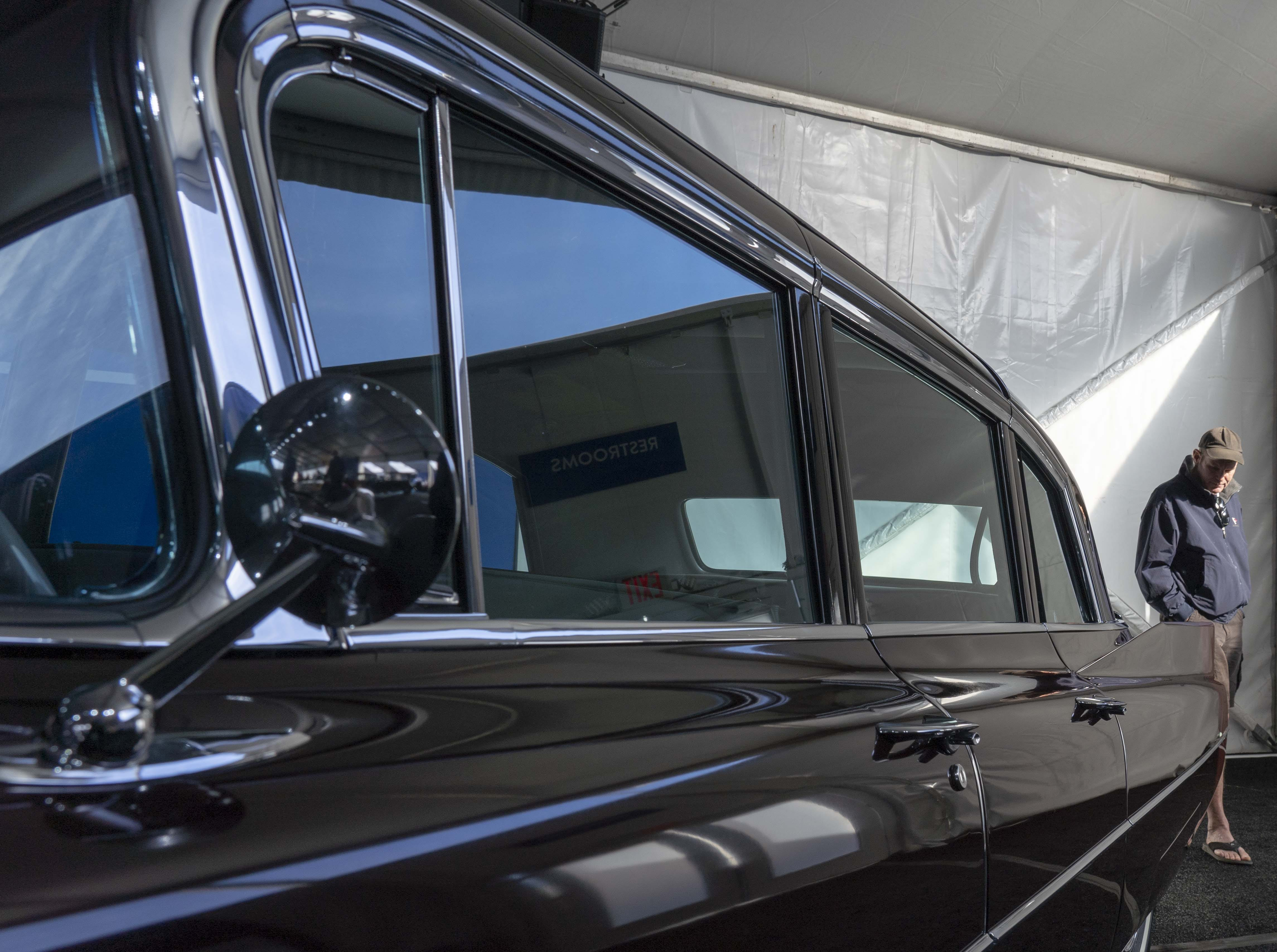 Tim McDonald look at 1963 Cadillac Series 75 Eight-Passenger Sedan for auction at Gooding & Co.'s preview day in Scottsdale.